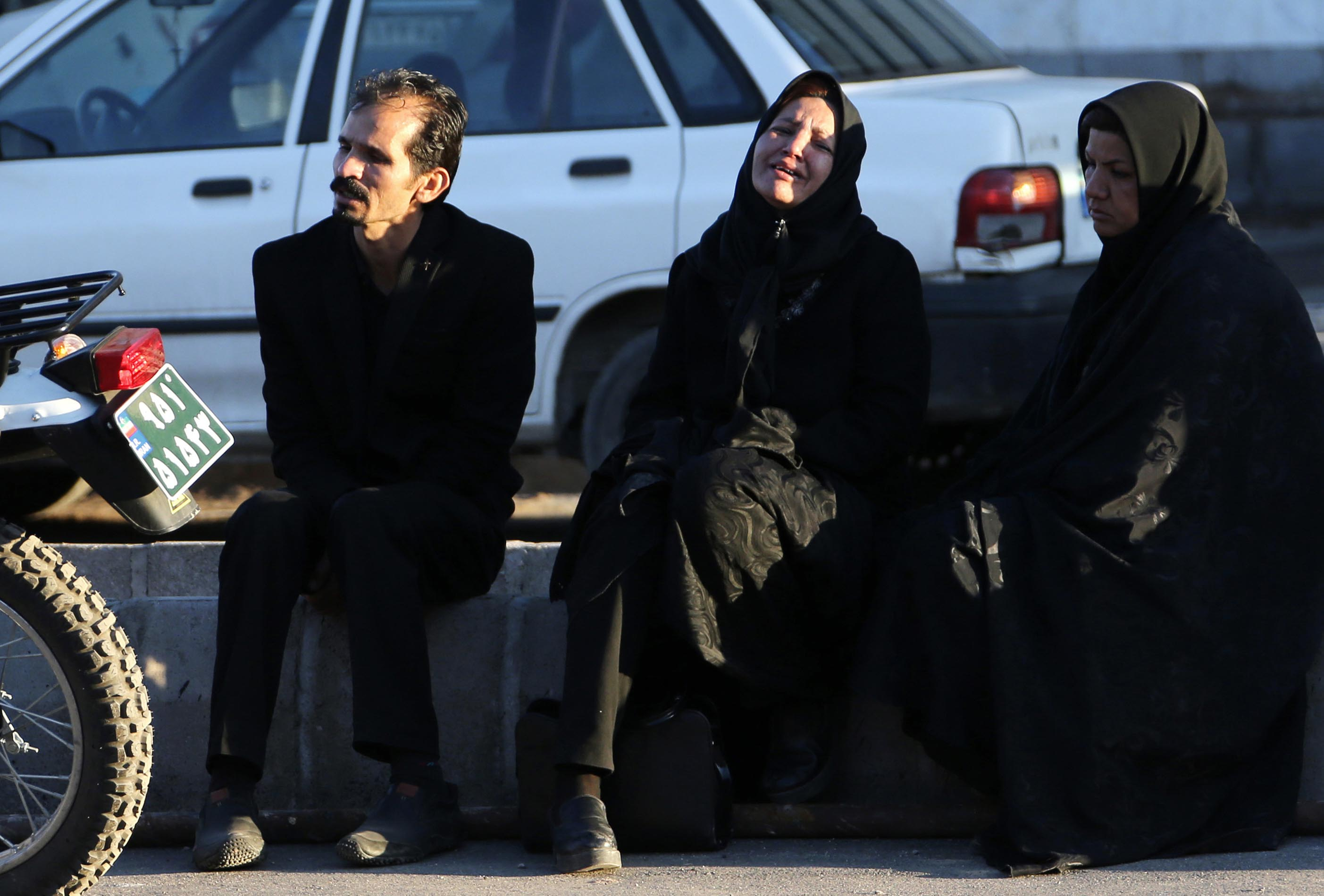 Relatives of stampede victims wait outside Bahonar hospital in Kerman. Credit: Attar Kenare/AFP via Getty Images)