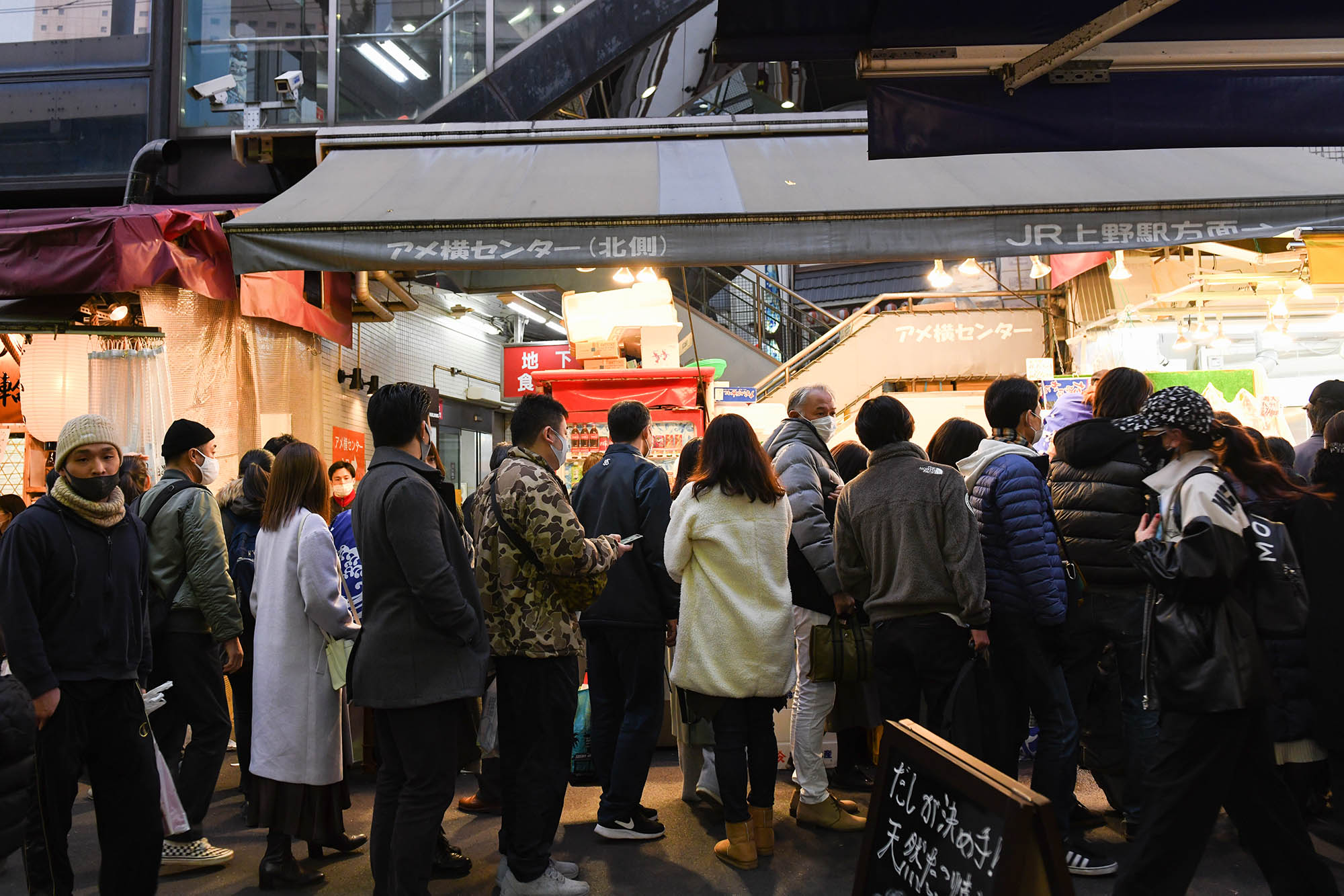 Shoppers stand outside stores at the Ameya Yokocho market in Tokyo, Japan, on Wednesday, December 30.