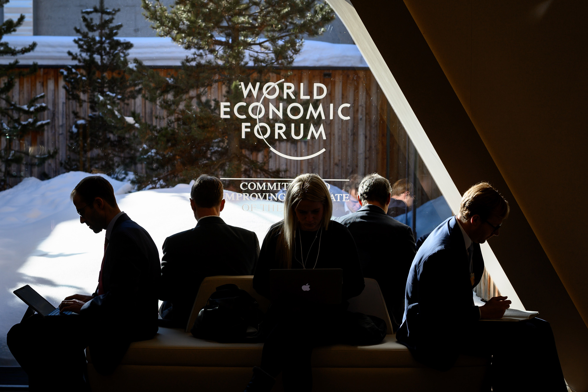 Participants sit near a window during the World Economic Forum annual meeting in Davos, on January 23.