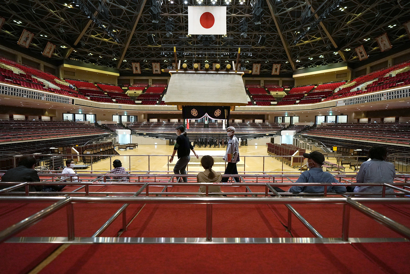 Elderly residents of Sumida Ward rest at box seats after receiving their first dose of Pfizer's Covid-19 vaccine at the Ryogoku Kokugikan sporting arena, in Tokyo on Monday, May 24.