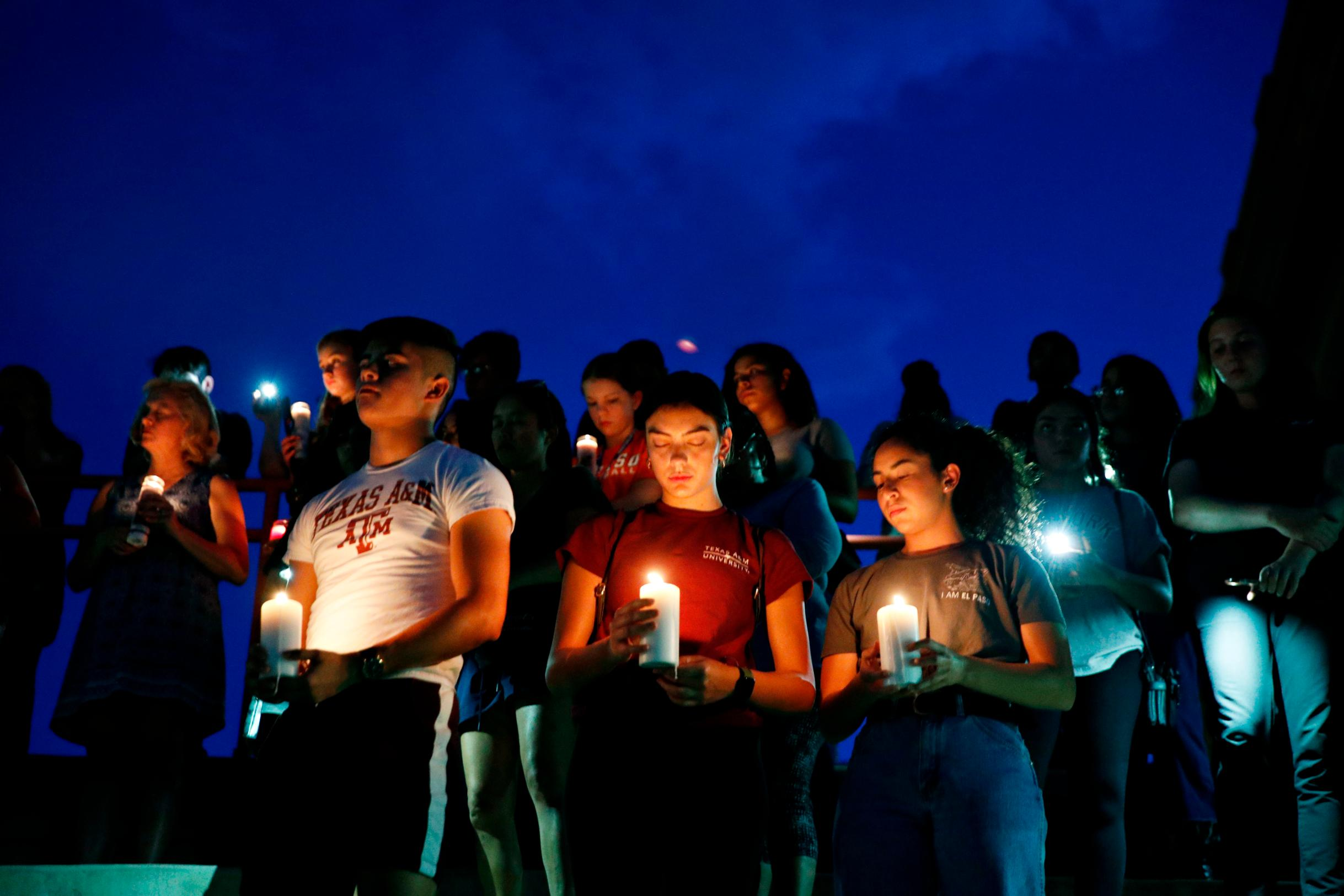 From left, Samuel Lerma, Arzetta Hodges and Desiree Quintanar attend a vigil for victims of the deadly shooting in El Paso on Saturday.