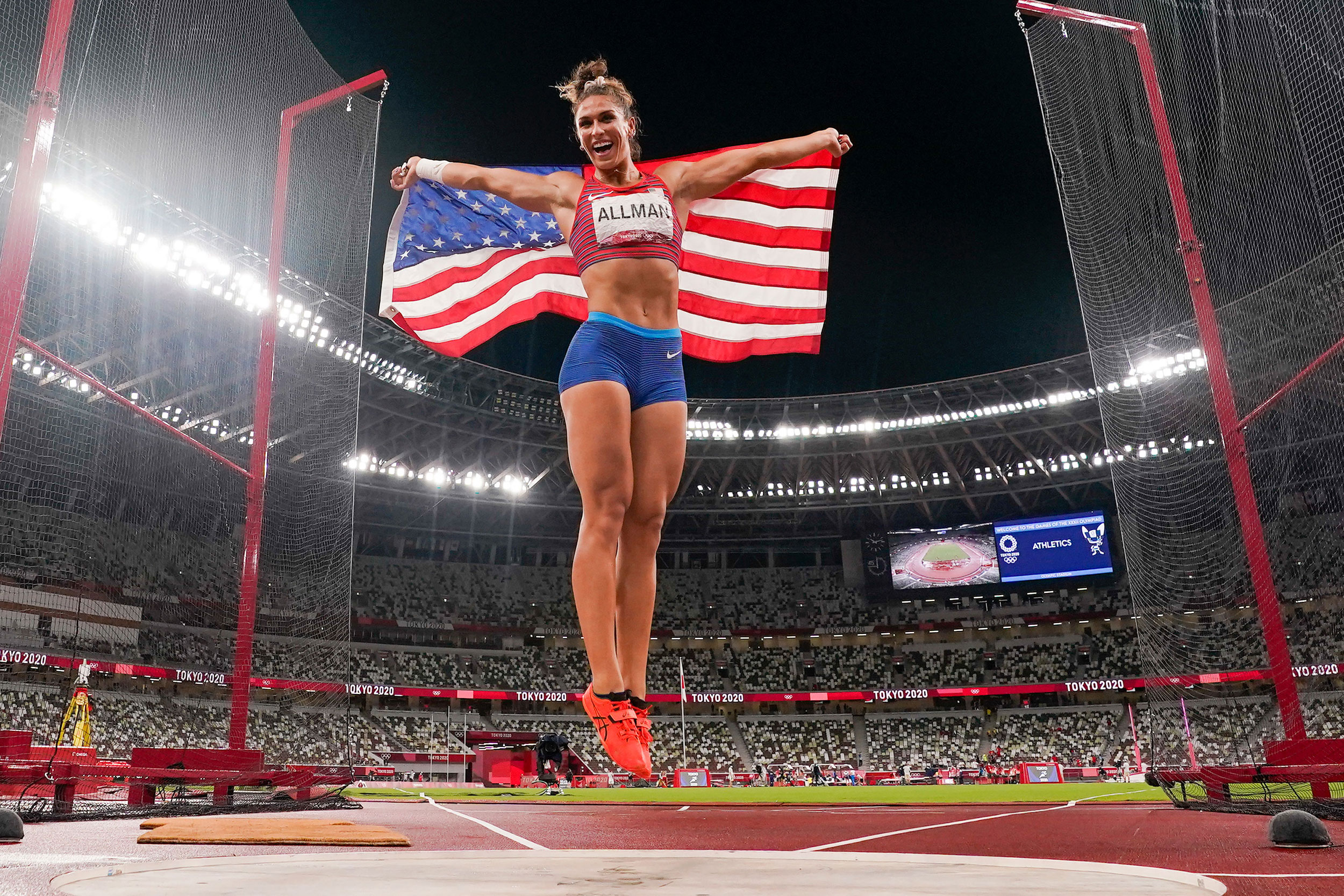 American Valarie Allman celebrates after winning gold in the discus throw on August 2.