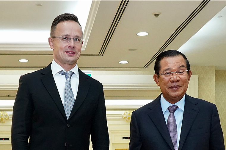 Hungarian Foreign Minister Peter Szijjarto, left, with Cambodian Prime Minister Hun Sen in Phnom Penh, Cambodia,  Szijjarto tested positive for the coronavirus after arriving in Thailand for an official visit, Thai and Hungarian officials said Wednesday, Nov. 4, 2020.