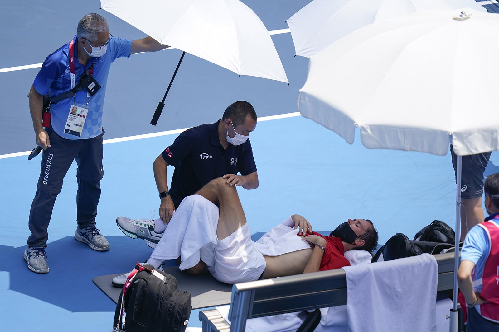 Daniil Medvedev of the Russian Olympic Committee is tended to during a third round men's tennis match on Wednesday.