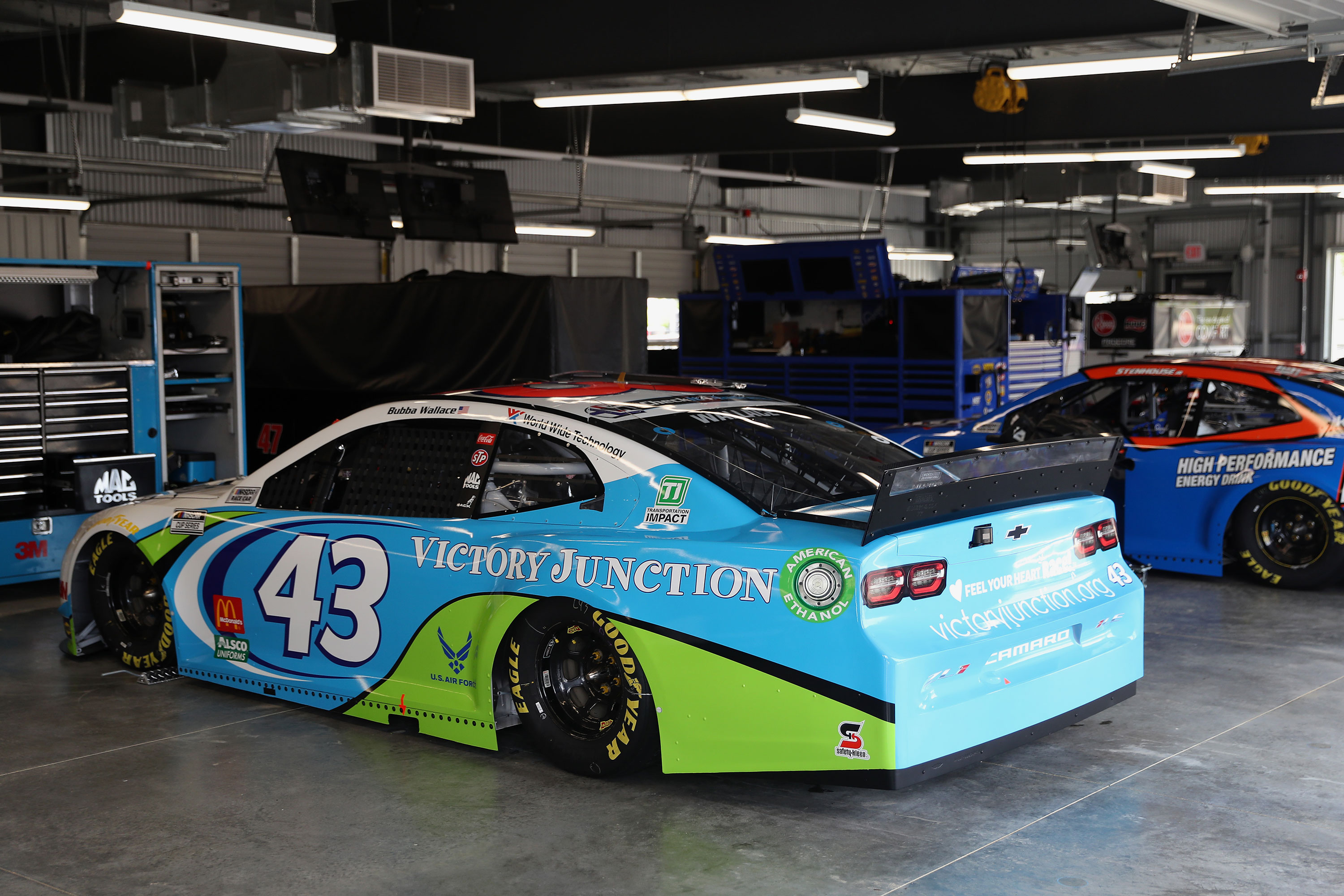 The #43 Victory Junction Chevrolet, driven by Bubba Wallace, sits in the garage area prior to the NASCAR Cup Series GEICO 500 at Talladega Superspeedway on June 22 in Talladega, Alabama.