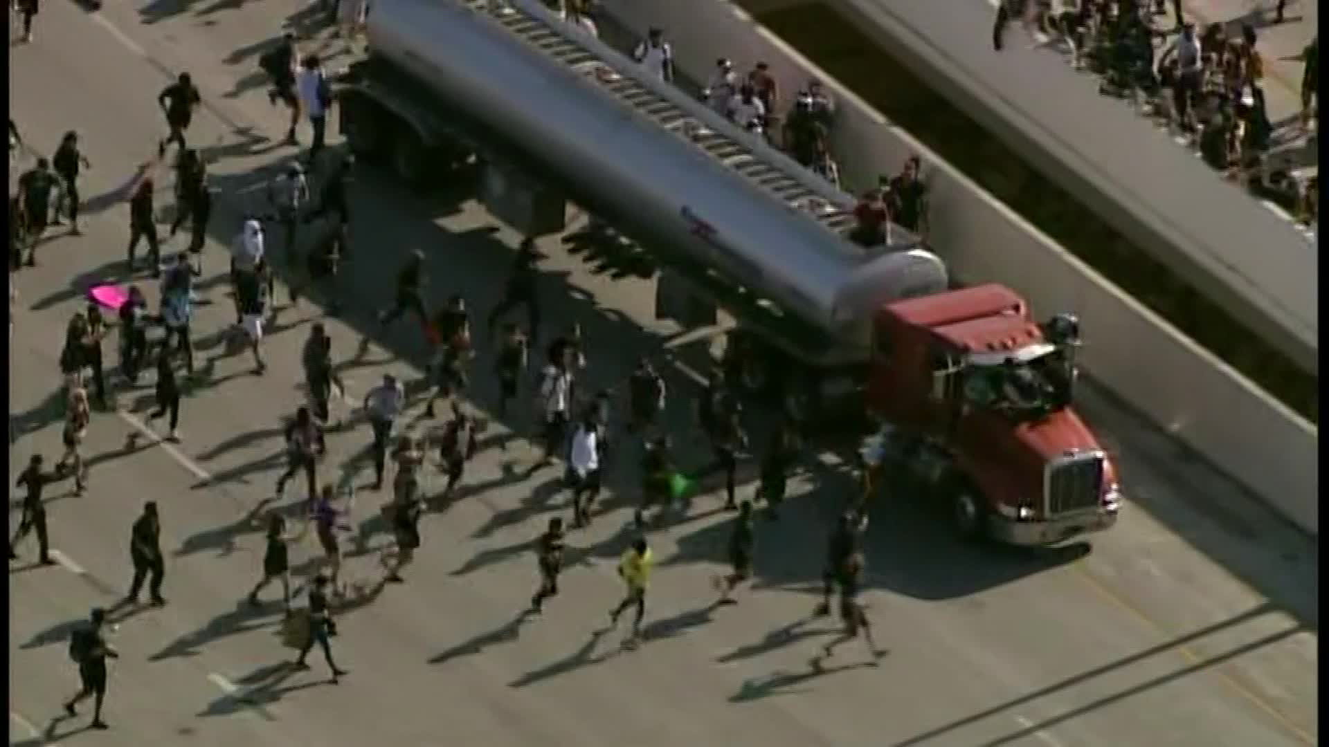 Minneapolis protesters converge on a truck driving on the freeway on May 31, 2020.