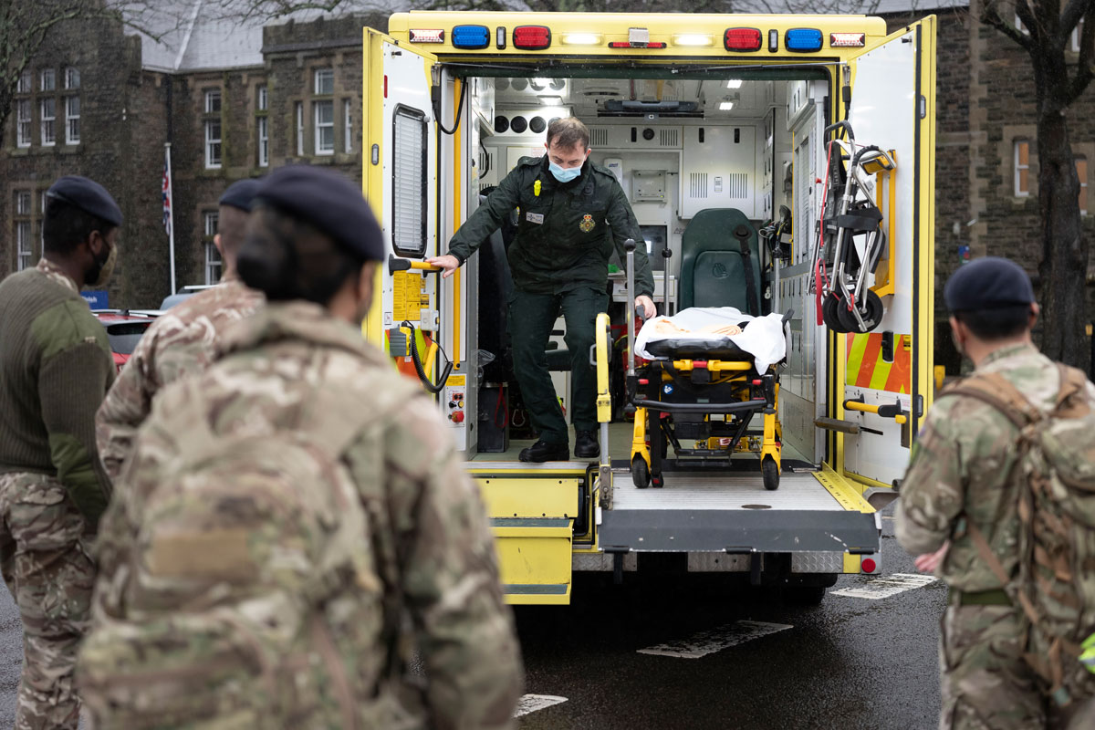 Members of the military practice loading and unloading a stretcher into an ambulance at Maindy Barracks on December 23, 2020 in Cardiff, Wales.