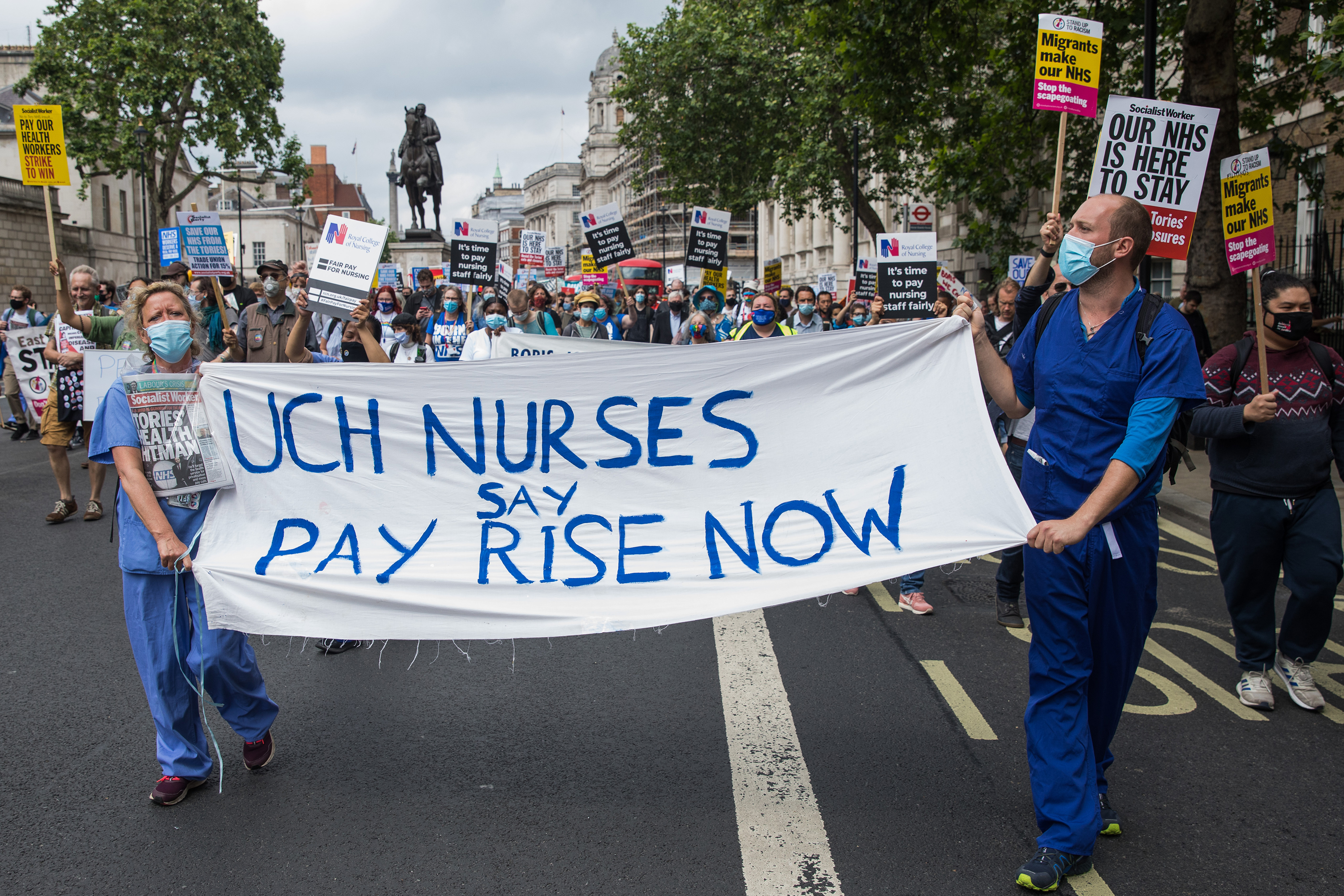 Healthcare workers and supporters take part in a protest march from University College Hospital to Whitehall on July 3, in London.