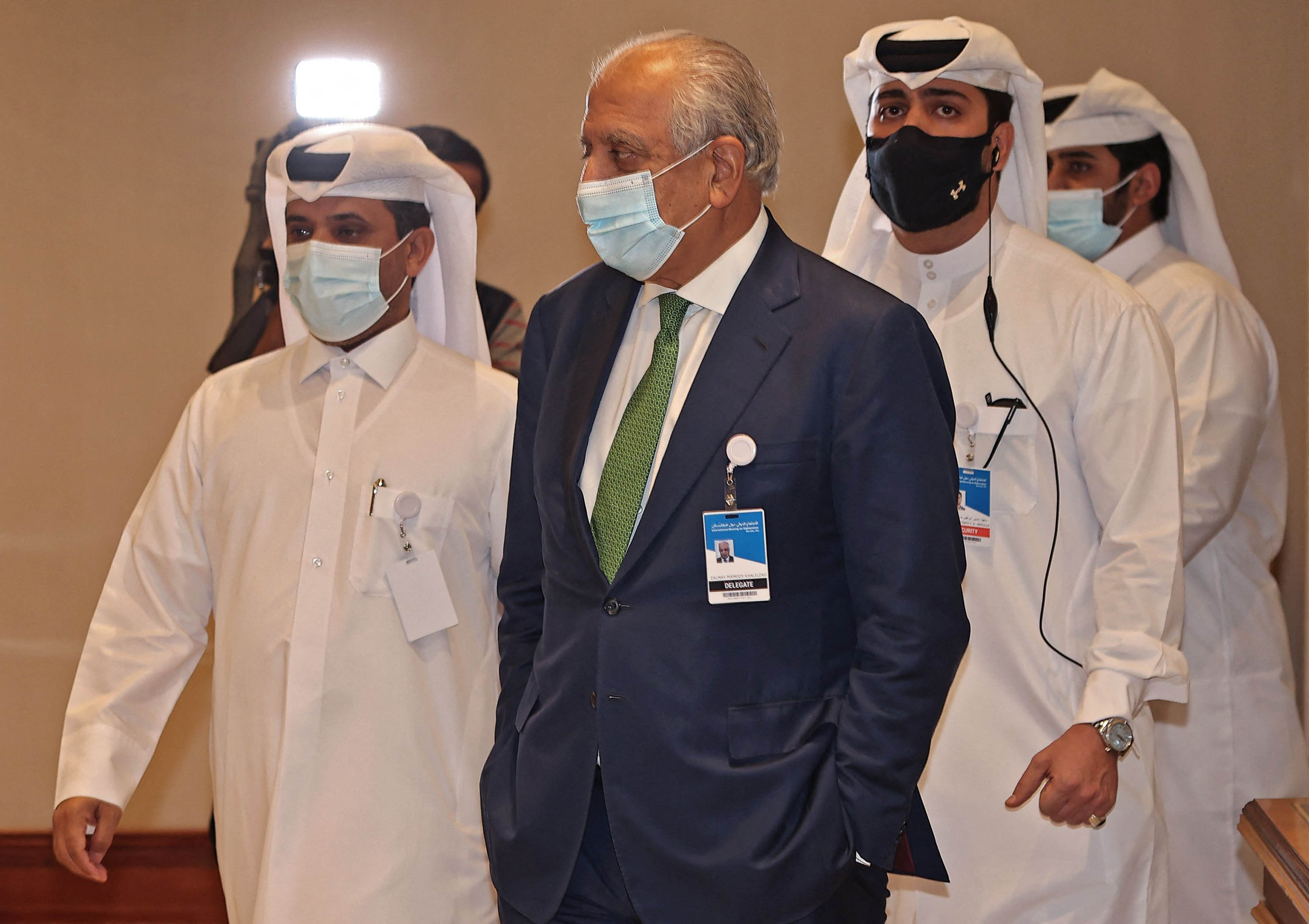 US special envoy for Afghanistan Zalmay Khalilzad, center, is seen at a hotel in Doha, Qatar, during an international meeting on the escalating conflict in Afghanistan, on August 12.
