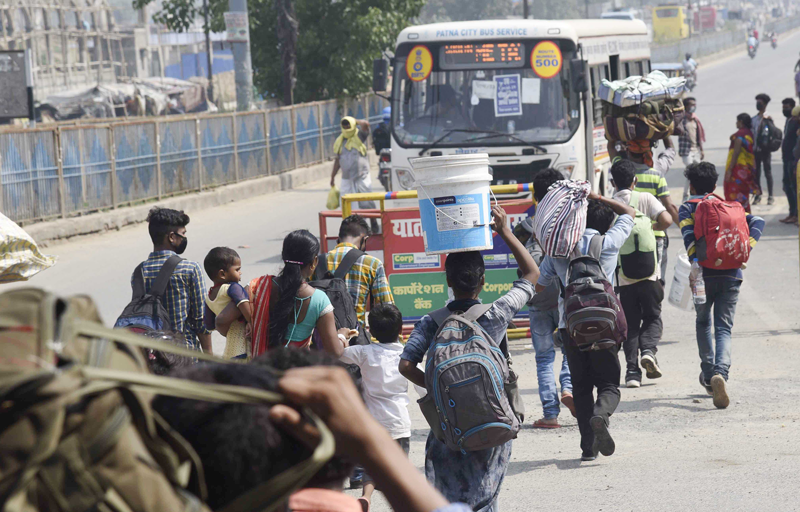 Migrants headed to their homes are seen walking along National Highway NH-30 in Patna, India, on May 18.