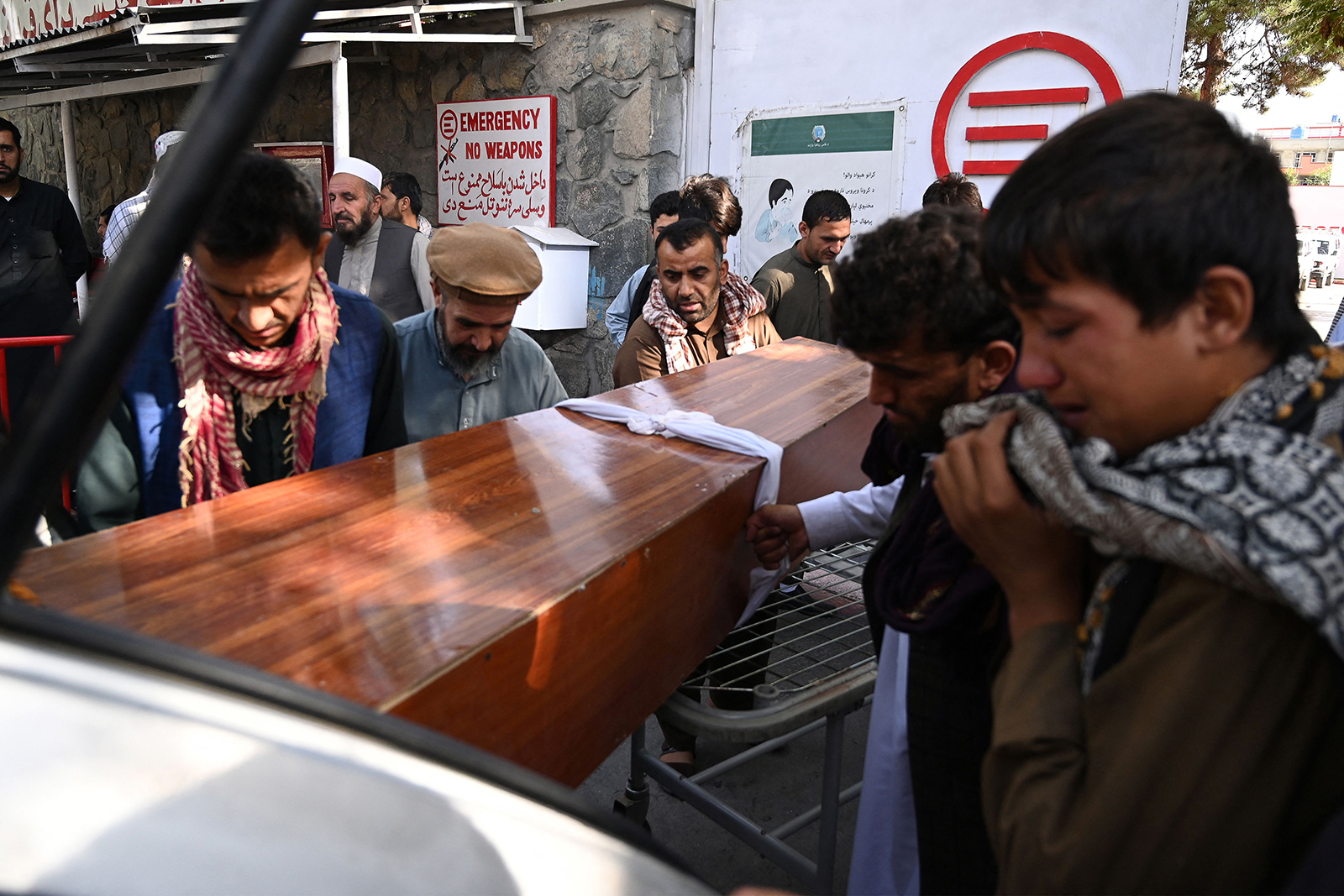 Relatives load in a car the coffin of a victim of the explosion at the Abbey gateat Hamid Karzai International airport on Friday, August 27, in Kabul.