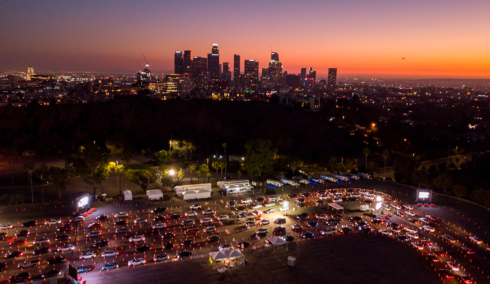 This aerial view shows cars lined up at the Dodger Stadium parking lot for Covid-19 testing with the Los Angeles skyline in the distance, on November 14.