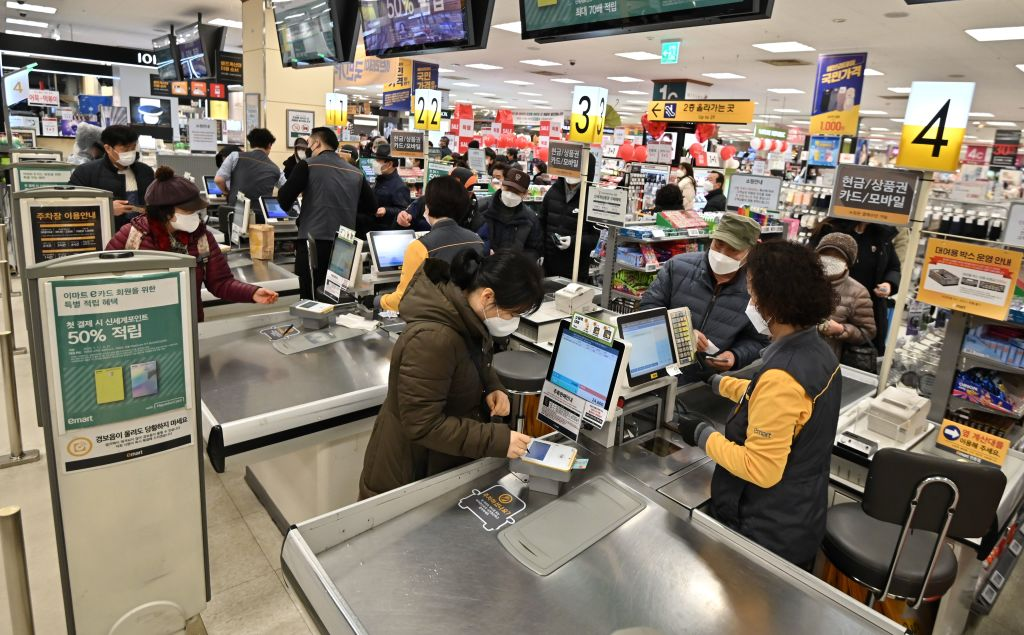 People buy face masks at a retail store in Daegu on February 25.