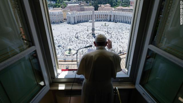 Pope Francis delivers a blessing from his studio window overlooking St. Peter's Square at the Vatican on May 31.