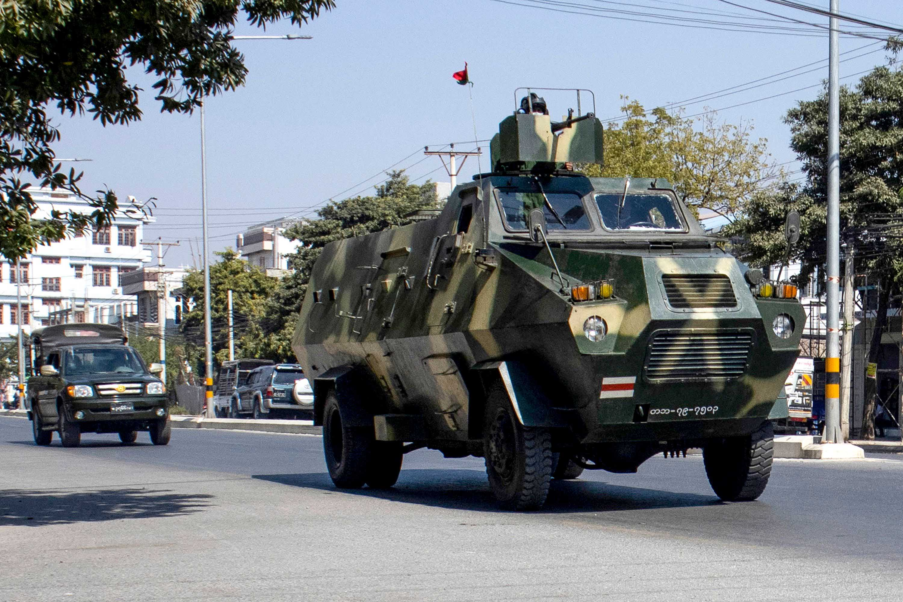 Military vehicles are seen along a street in Mandalay, Myanmar, on February 2.