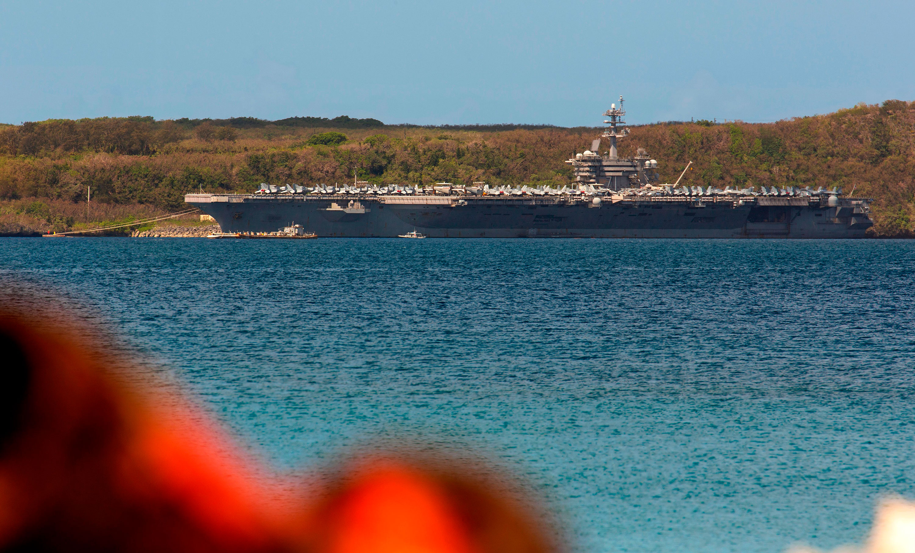 The aircraft carrier USS Theodore Roosevelt is seen docked at Naval Base Guam in Apra Harbor on April 10.