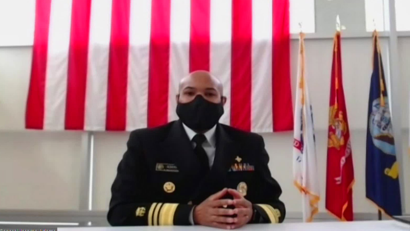 US Surgeon General Dr. Jerome Adams speaks during a news conference on Saturday, December 19.