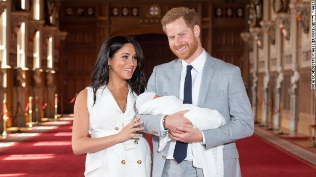 Prince Harry, Duke of Sussex and Meghan, Duchess of Sussex, pose with their son Archie during a photocall in St George's Hall at Windsor Castle on May 8, 2019.