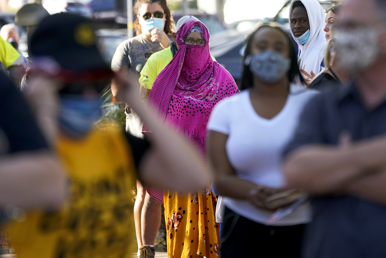 Voters wait in line outside a polling station, Tuesday, Nov. 3, 2020, in Tempe, Arizona.