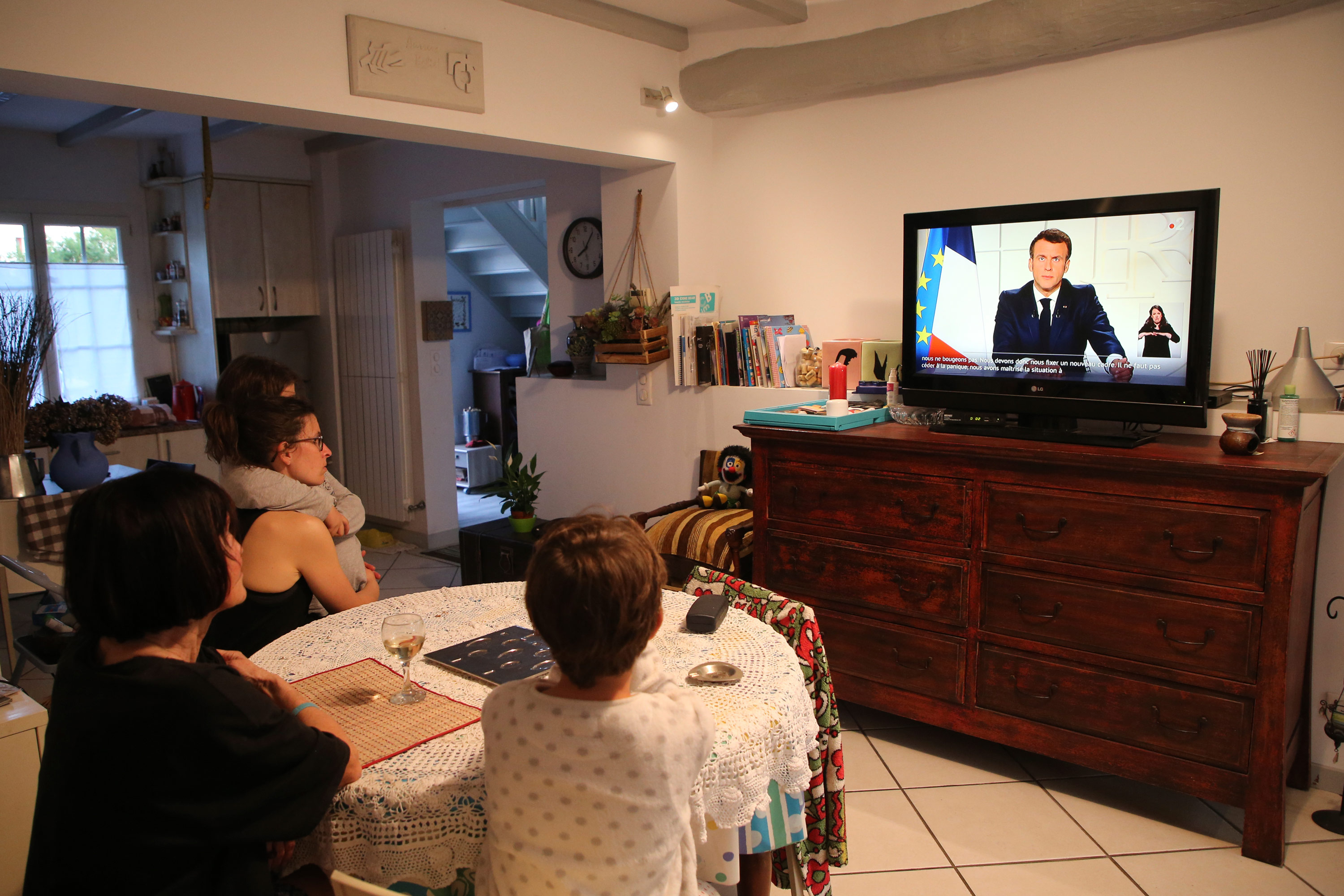 The Larragana family watch French President Emmanuel Macron addressing the nation in Ascain, France, on March 31.