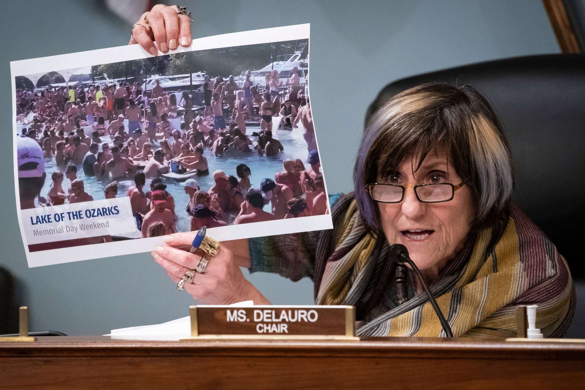 Representative Rosa DeLauro, a Democrat from Connecticut and chairwoman of the House Appropriations Subcommittee on Labor, Health and Human Services, Education, and Related Agencies, holds a photograph from the Lake of the Ozarks in Missouri on Memorial Day Weekend, during a hearing on Capitol Hill in Washington, D.C., U.S., on June 4.