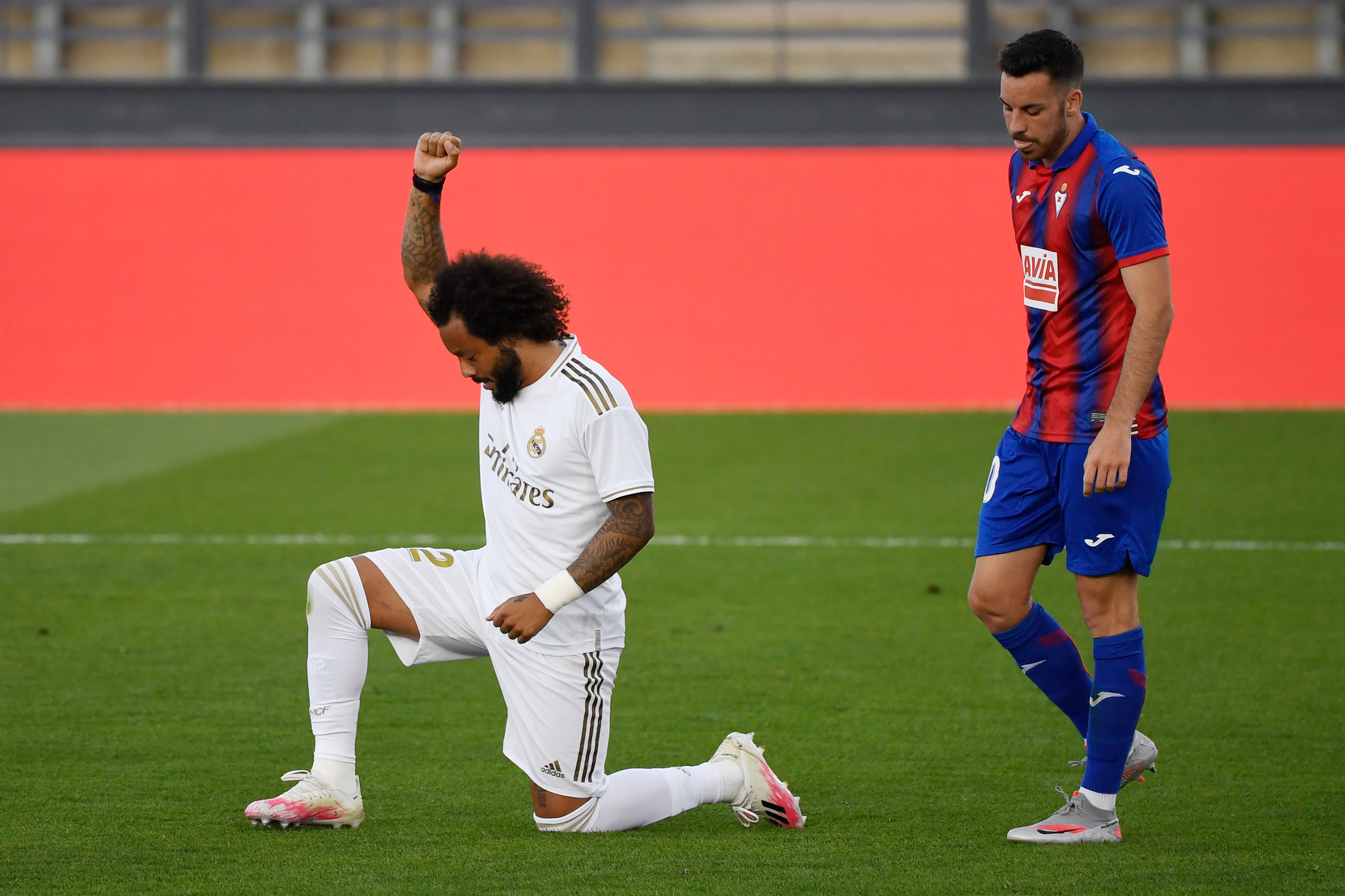 Real Madrid's Marcelo kneels after scoring a goal in the match against Eibar on June 14 in Madrid, Spain.