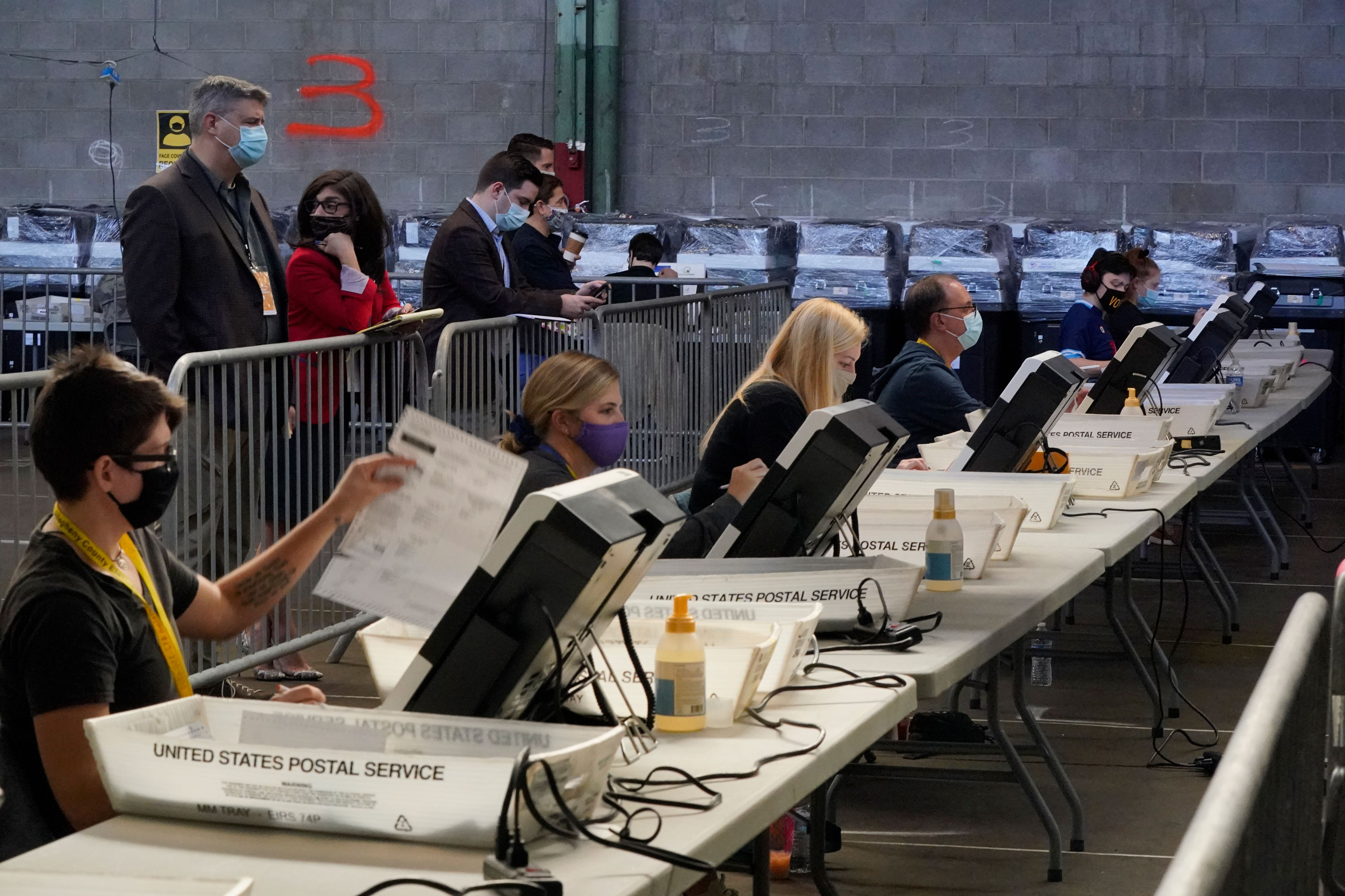 Election office workers process ballots at the Allegheny County elections returns warehouse in Pittsburgh, Pennsylvania, on November 6.