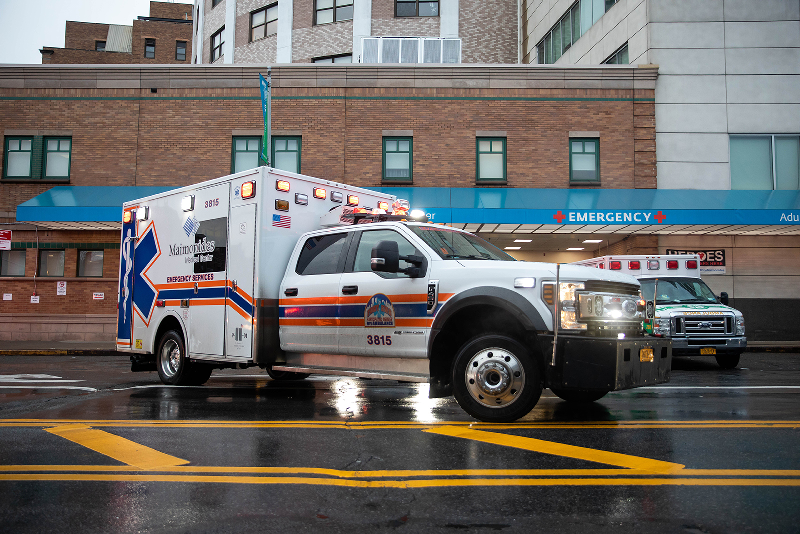 An ambulance arrives at the emergency room entrance of Maimonides Medical Center in Brooklyn, New York, on December 14.