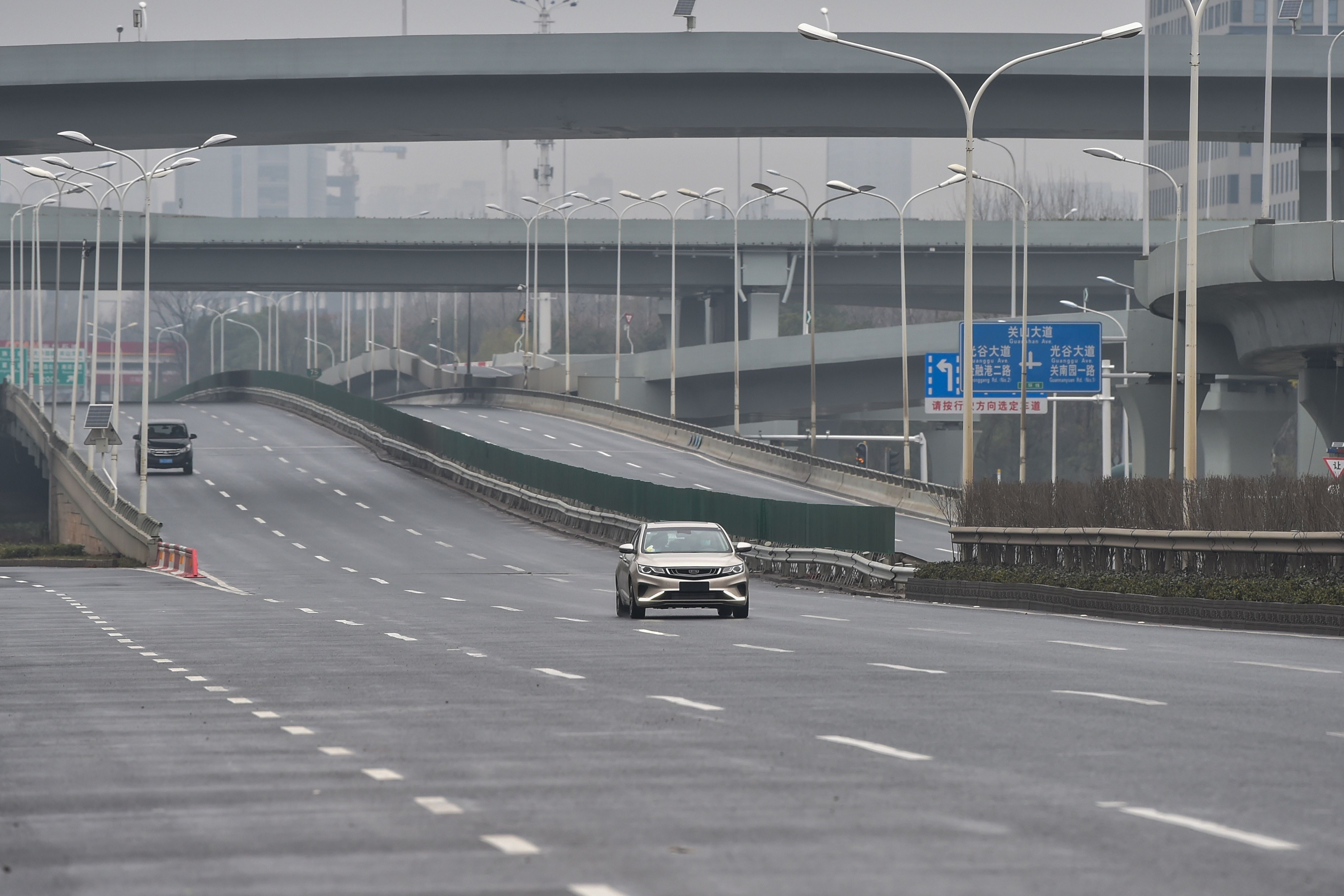 Cars are seen on a road on the first day of the Lunar New Year in Wuhan on Saturday.