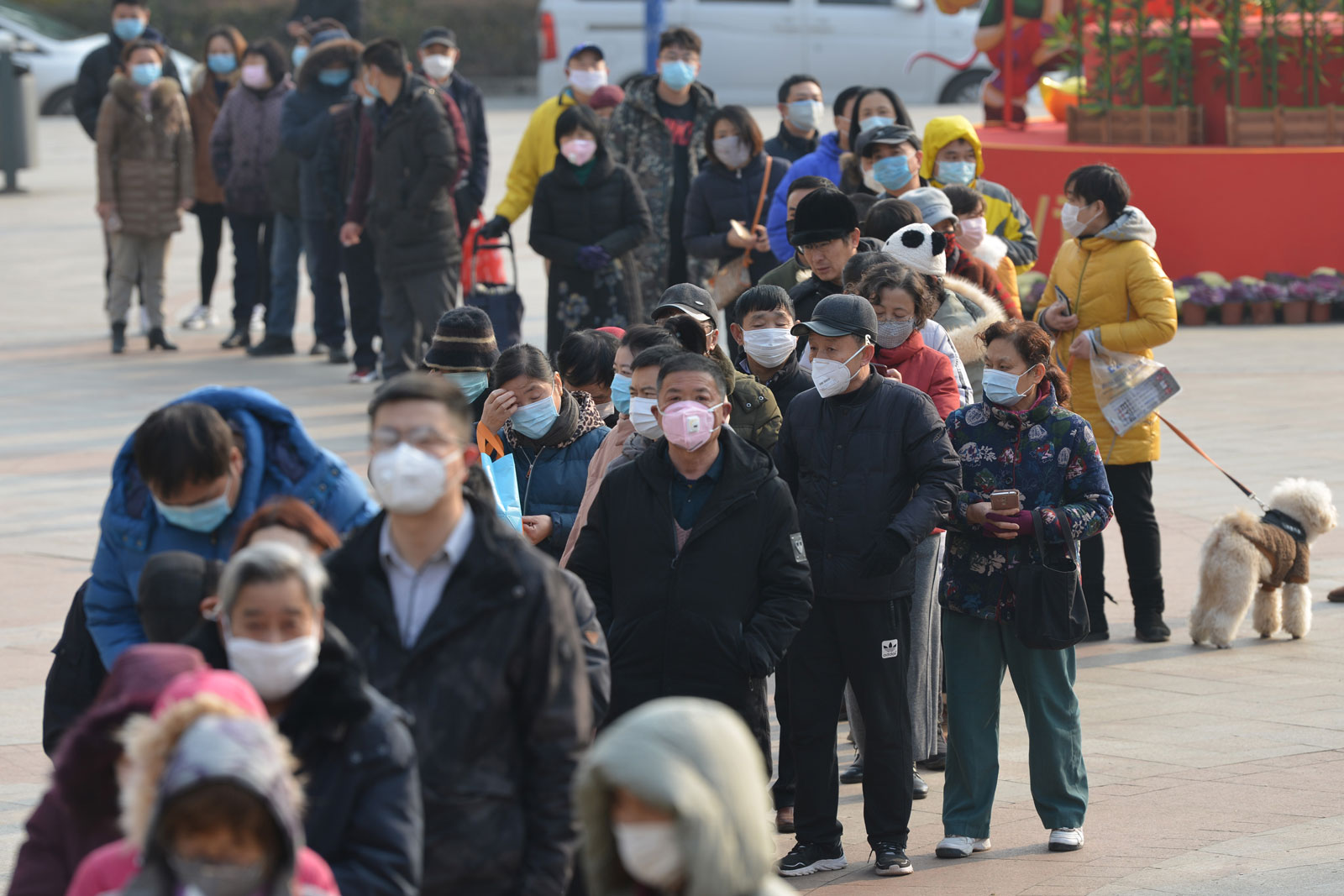 People line up outside a drugstore to buy medical masks in Nanjing, China, on Wednesday, January 29.