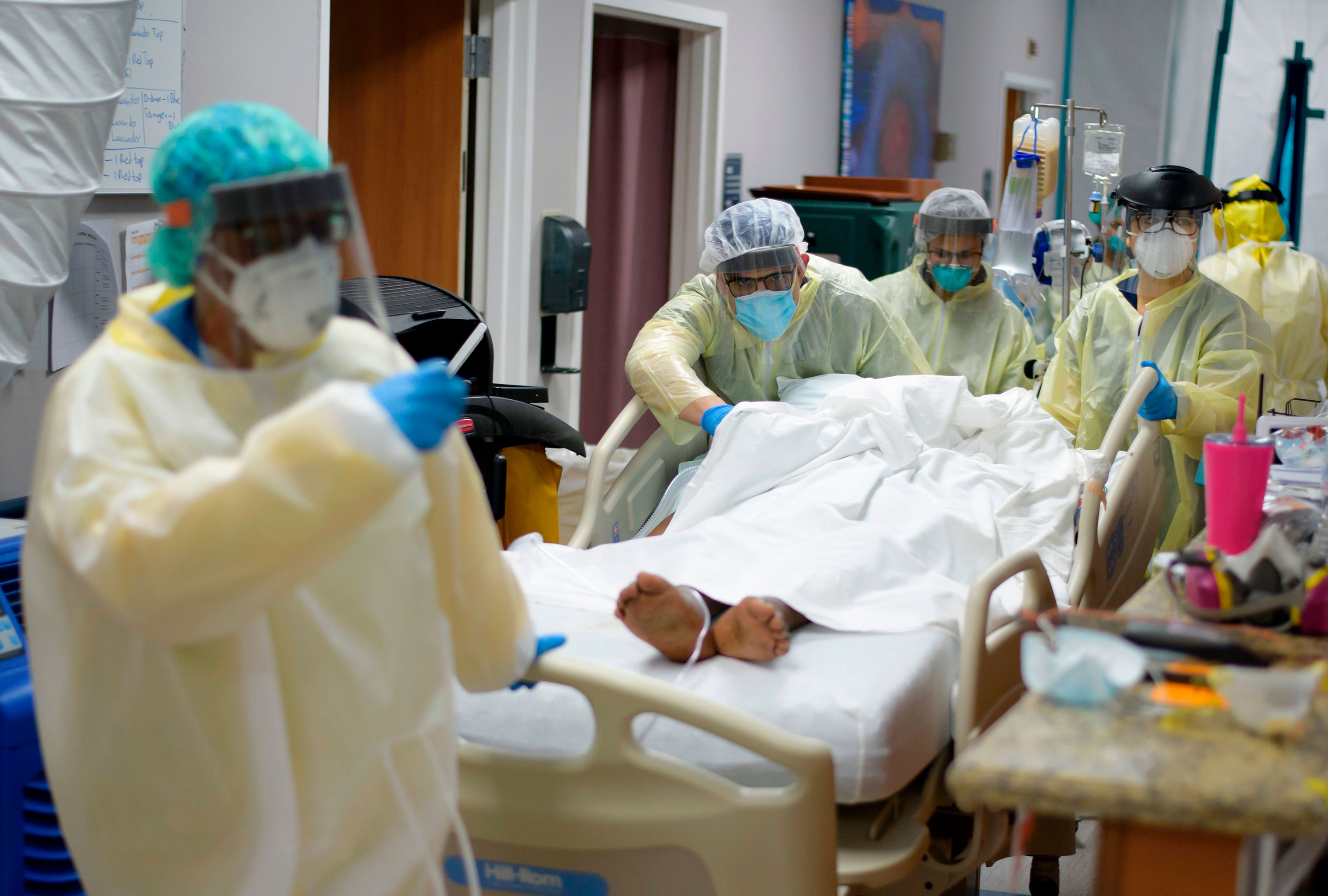 Healthcare workers move a patient in the Covid-19 Unit at United Memorial Medical Center in Houston, Texas, on July 2.