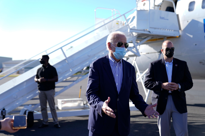 Former Vice President Joe Biden speaks to the press before boarding his campaign plane in New Castle, Delaware, on October 8.