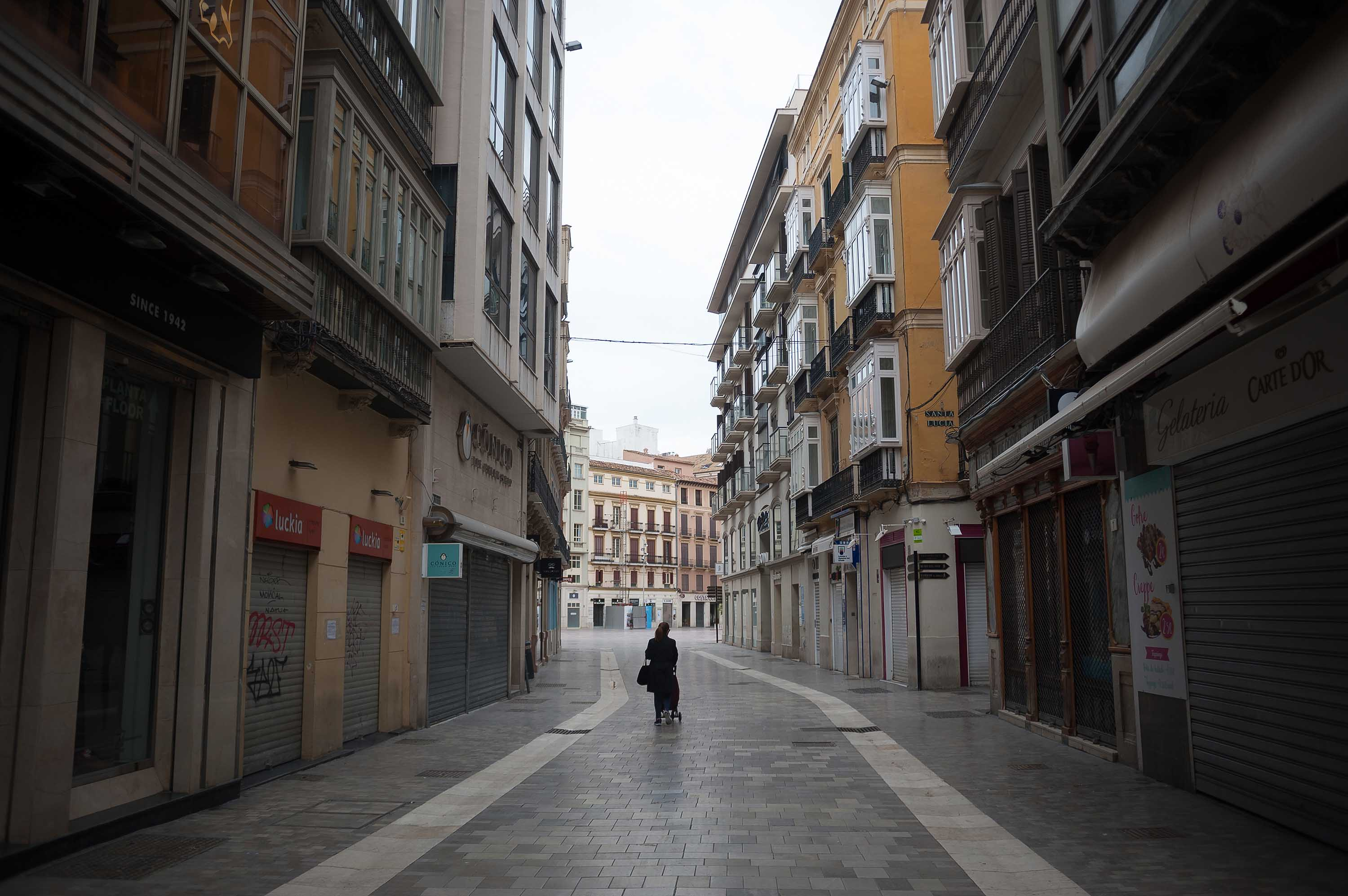 Shuttered businesses are seen on a street in Malaga, Spain, during lockdown on April 4.