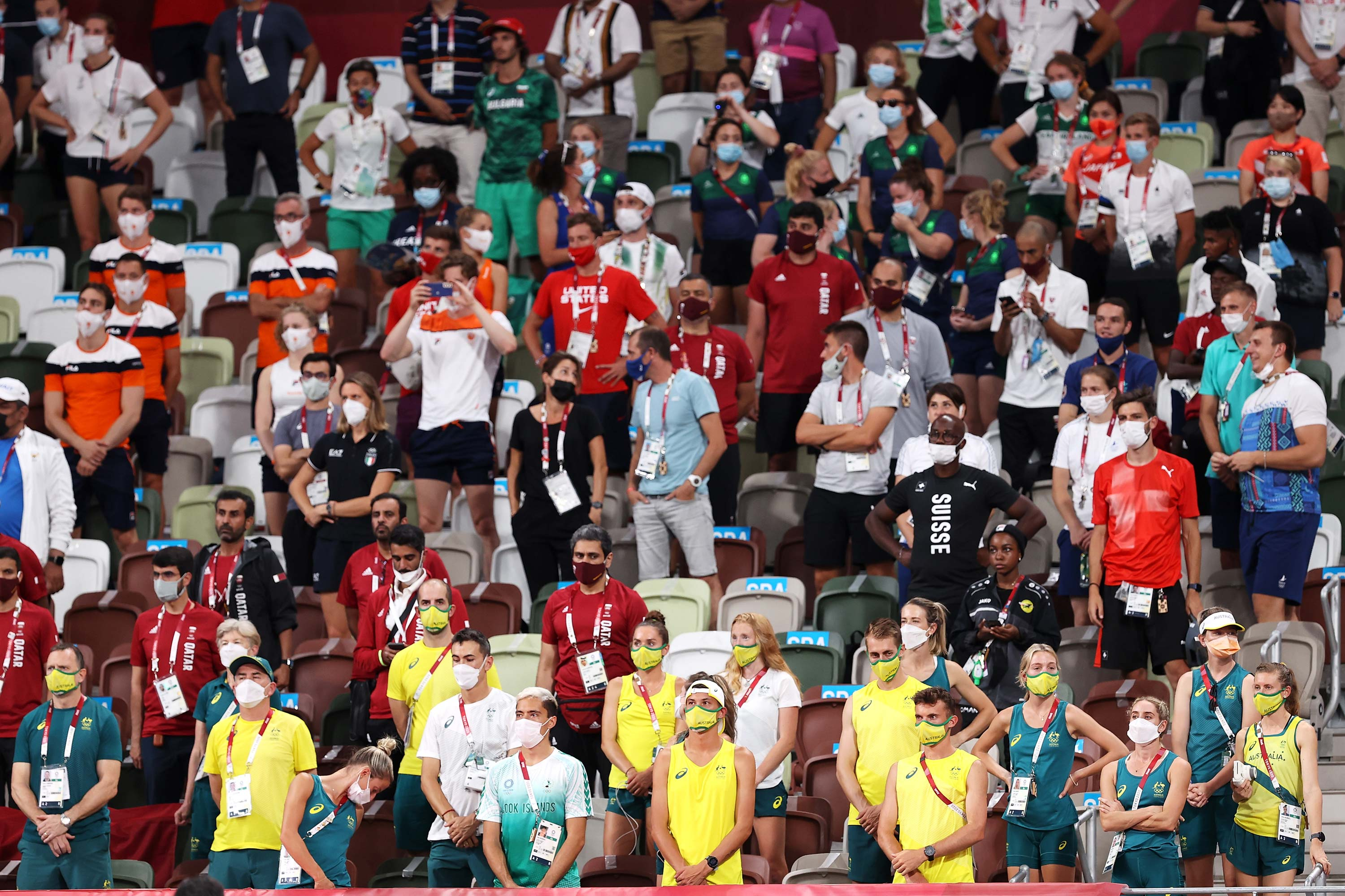 Athletes and officials look on from the stands on August 1 at the Olympic Stadium.