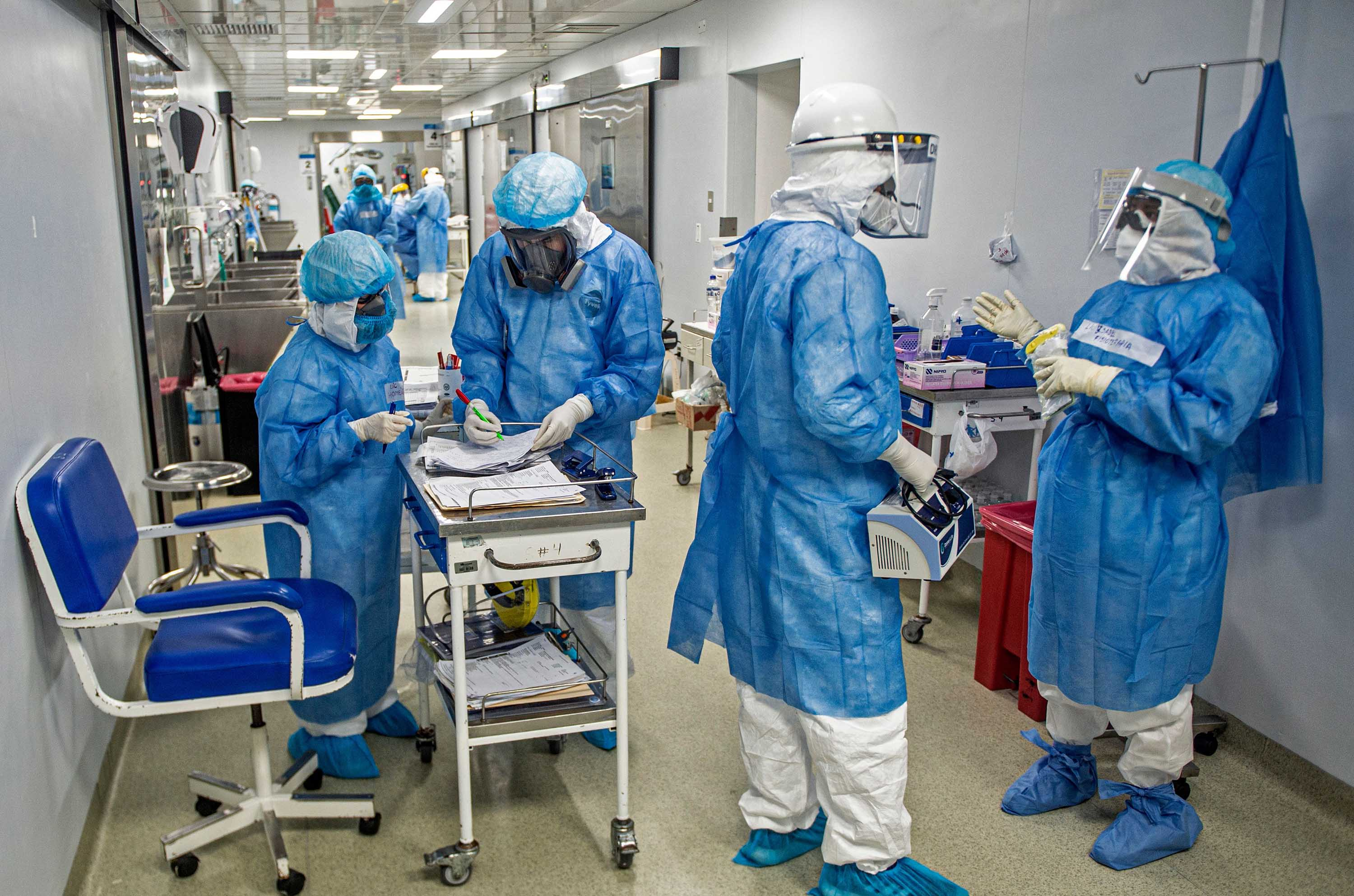 Health professionals are seen in the hall of the Intensive Care Unit of the Alberto Sabogal Sologuren Hospital, in Lima, Peru, on July 2.