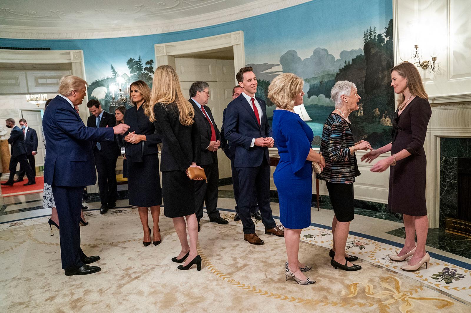 Barrett talks with Maureen Scalia, wife of late Supreme Court Justice Antonin Scalia.