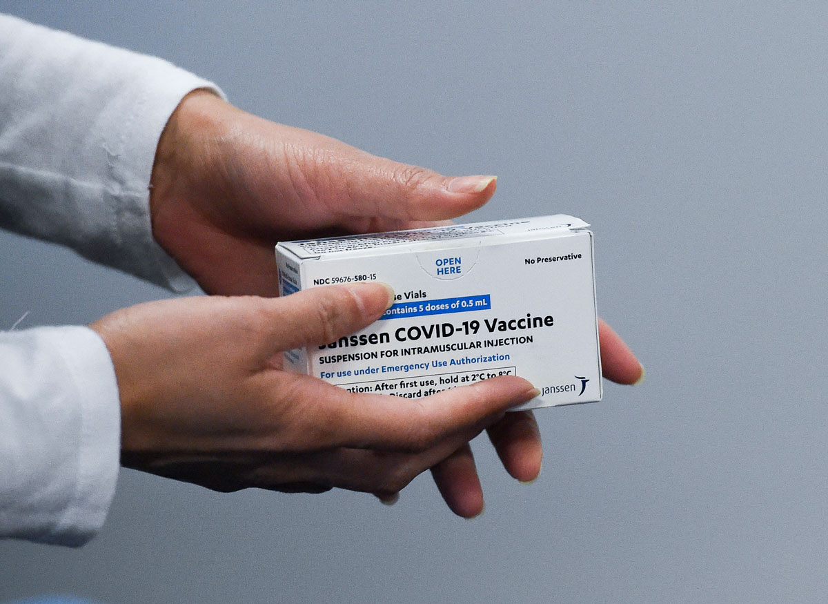 A health worker in Pennsylvania holds a box with the Janssen Johnson & Johnson Covid-19 vaccine on March 15.
