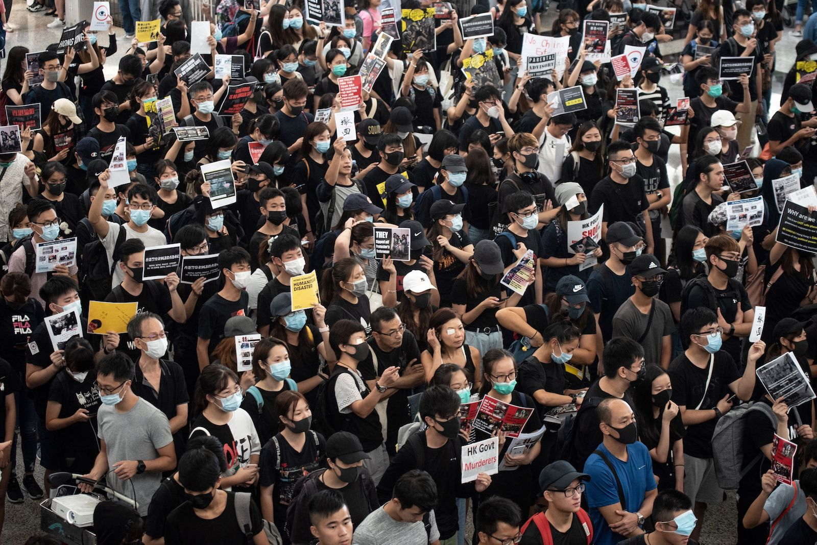 Protesters try to occupy the Hong Kong airport departures hall on August 13, 2019.