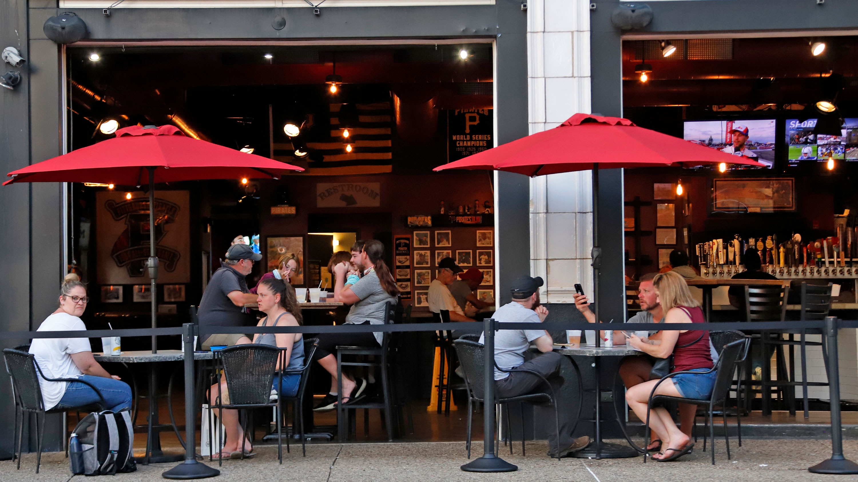 People dine at a restaurant on June 28 in Pittsburgh, Pennsylvania.