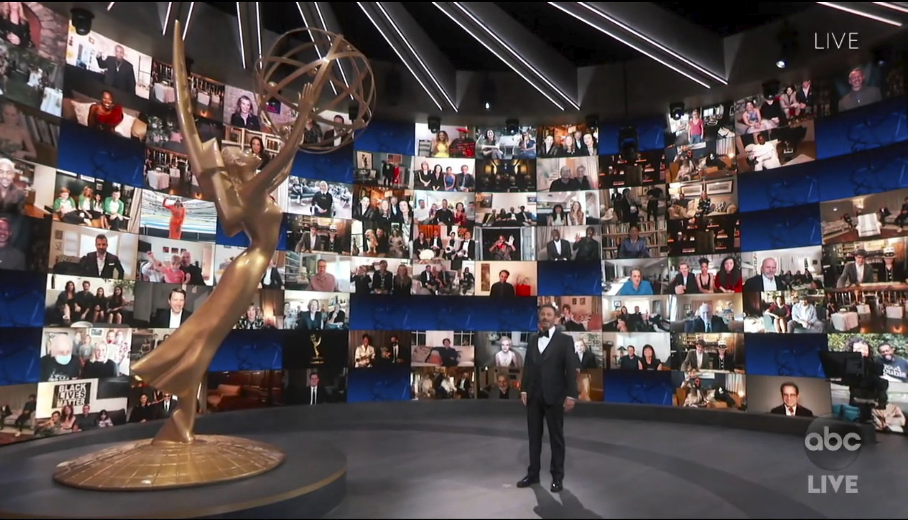 In this video grab captured on Sept. 20, 2020, courtesy of the Academy of Television Arts & Sciences and ABC Entertainment, host Jimmy Kimmel appears with a screen filled with nominees during the 72nd Emmy Awards broadcast.