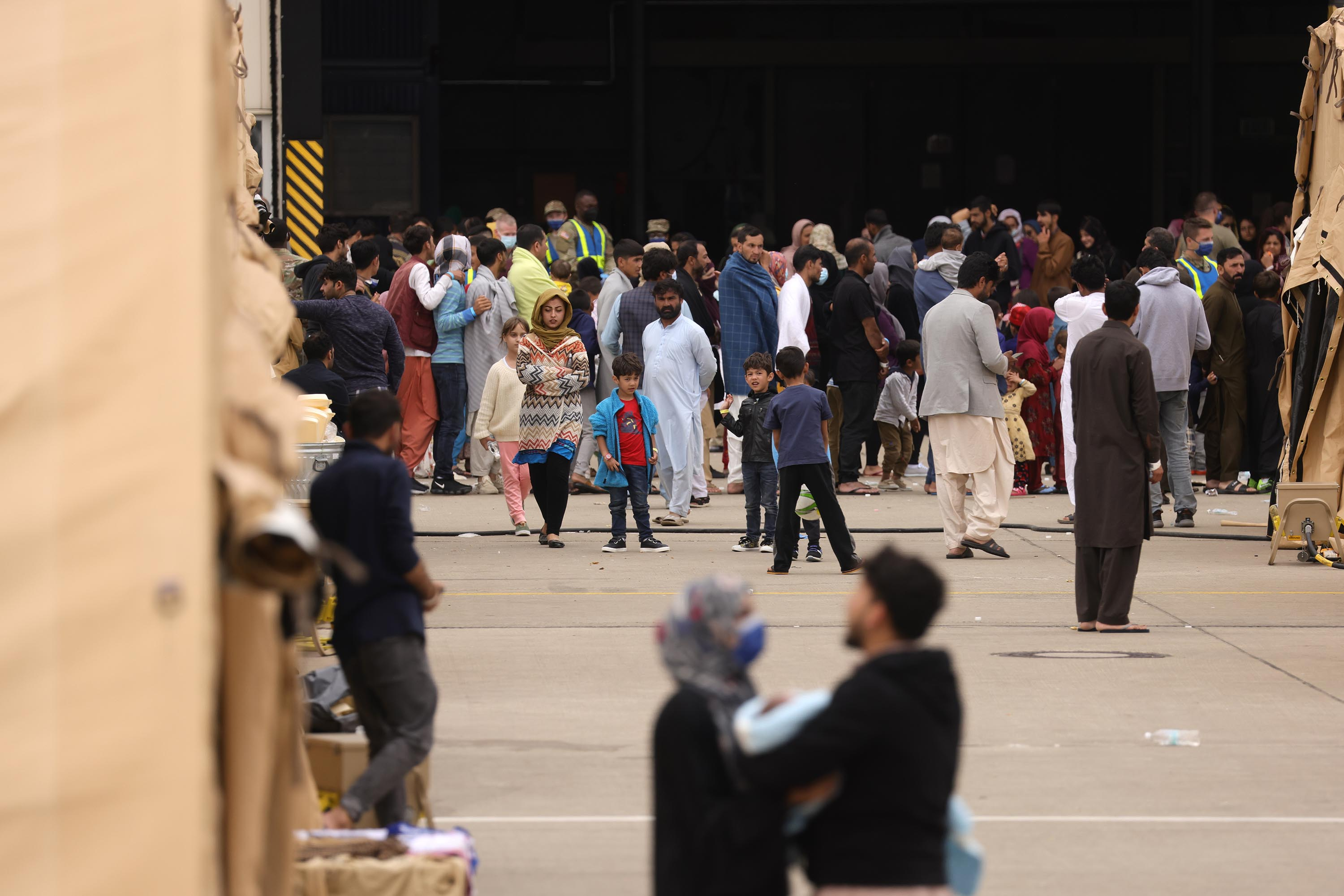 Evacuees from Afghanistan are seen at a temporary emergency shelter at the Ramstein Air Base on August 26, in Ramstein-Miesenbach, Germany.