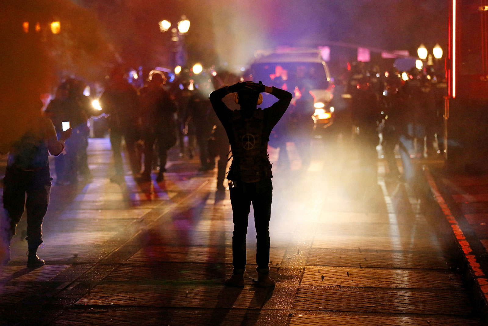 Protesters confront police while rallying in Portland, Oregon, on Saturday night.