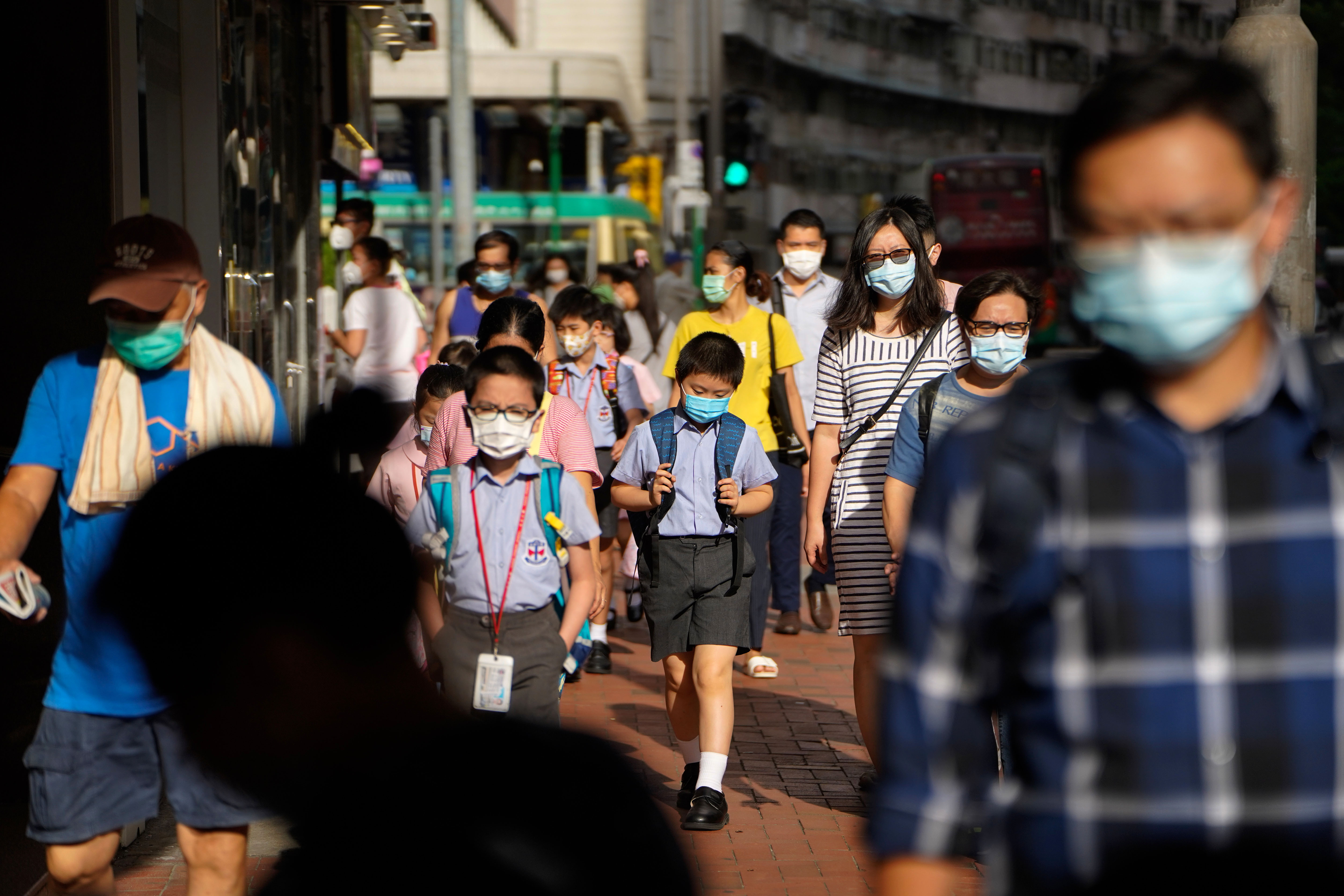 People walk in Hong Kong on July 10.