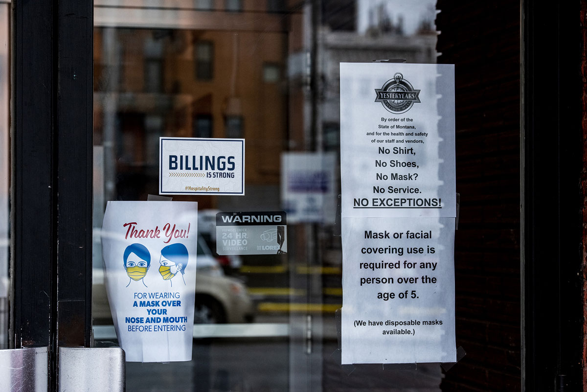 A sign requiring masks is seen outside a store in downtown Billings, Montana on November 11, 2020.