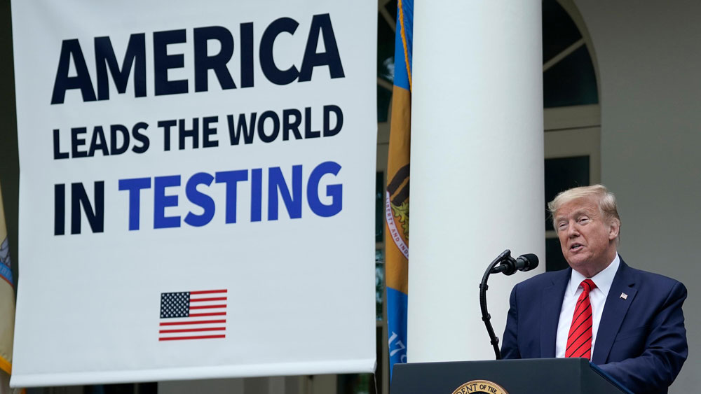 us President Donald Trump, flanked by tables holding testing supplies and machines, speaks during a news briefing about coronavirus testing in the Rose Garden of the White House on May 11 in Washington.