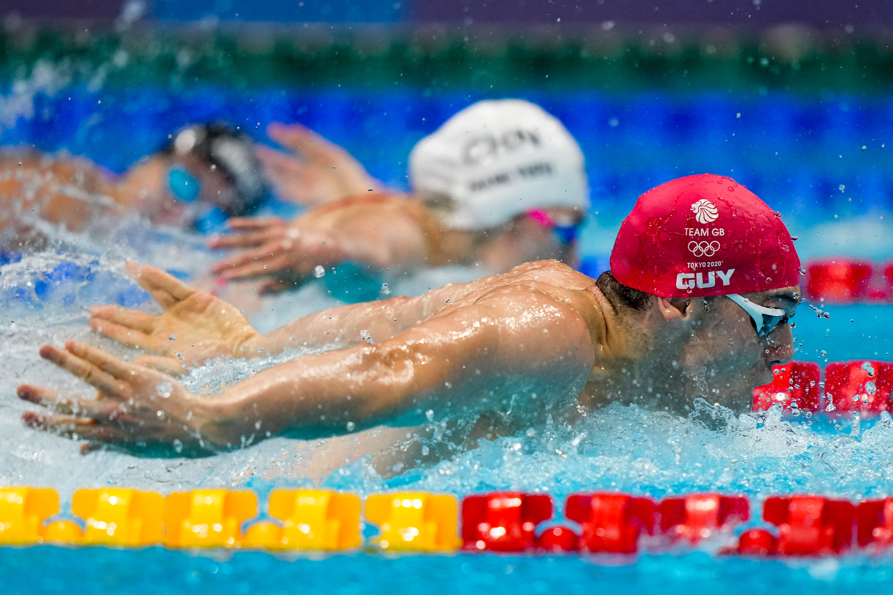 James Guy of Great Britain swims in the mixed 4x100-meter medley relay on July 31.
