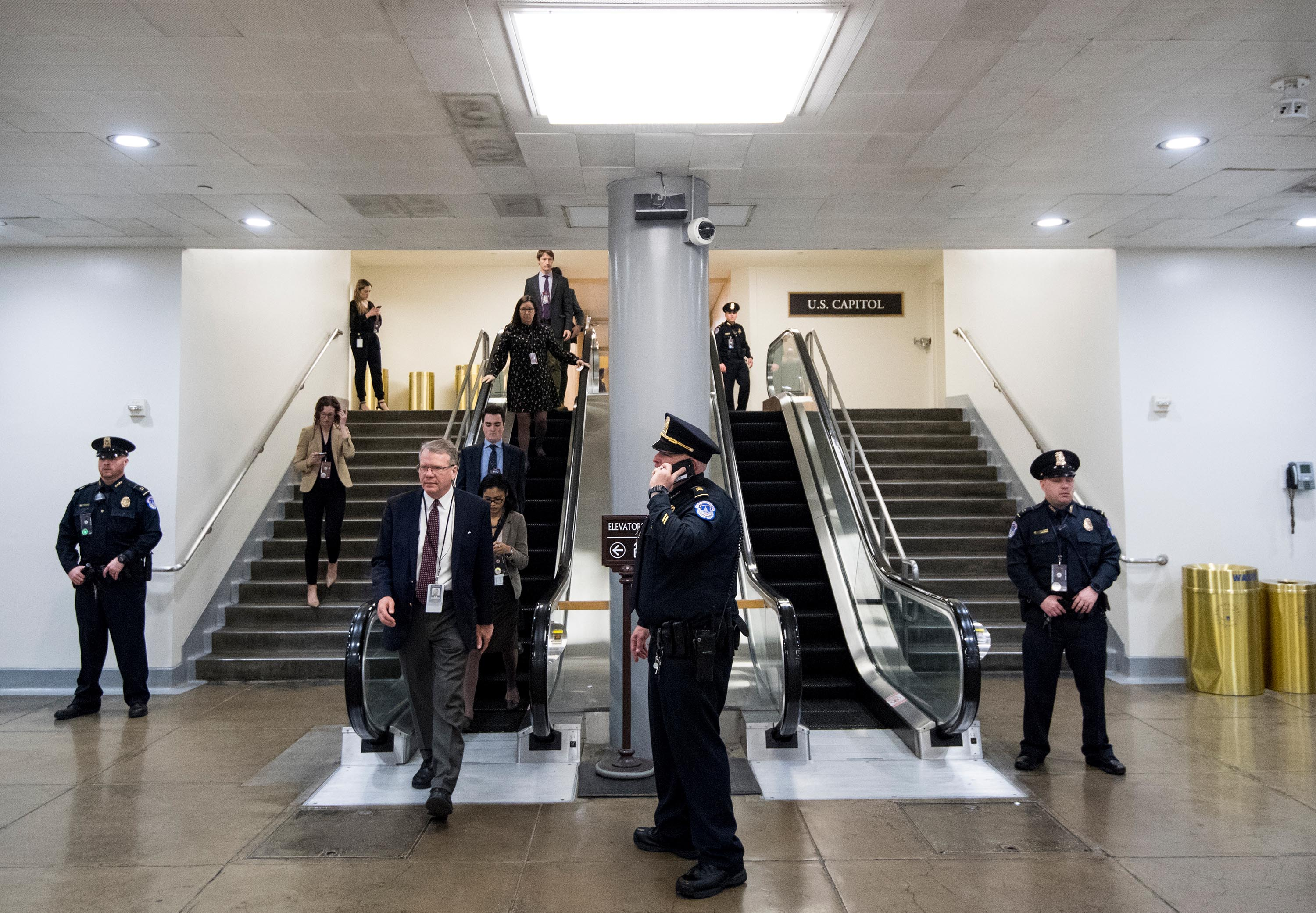 Reporters wait in the Senate subway area as Capitol Police make sure anyone entering the Capitol has a pass on Thursday, January 16.