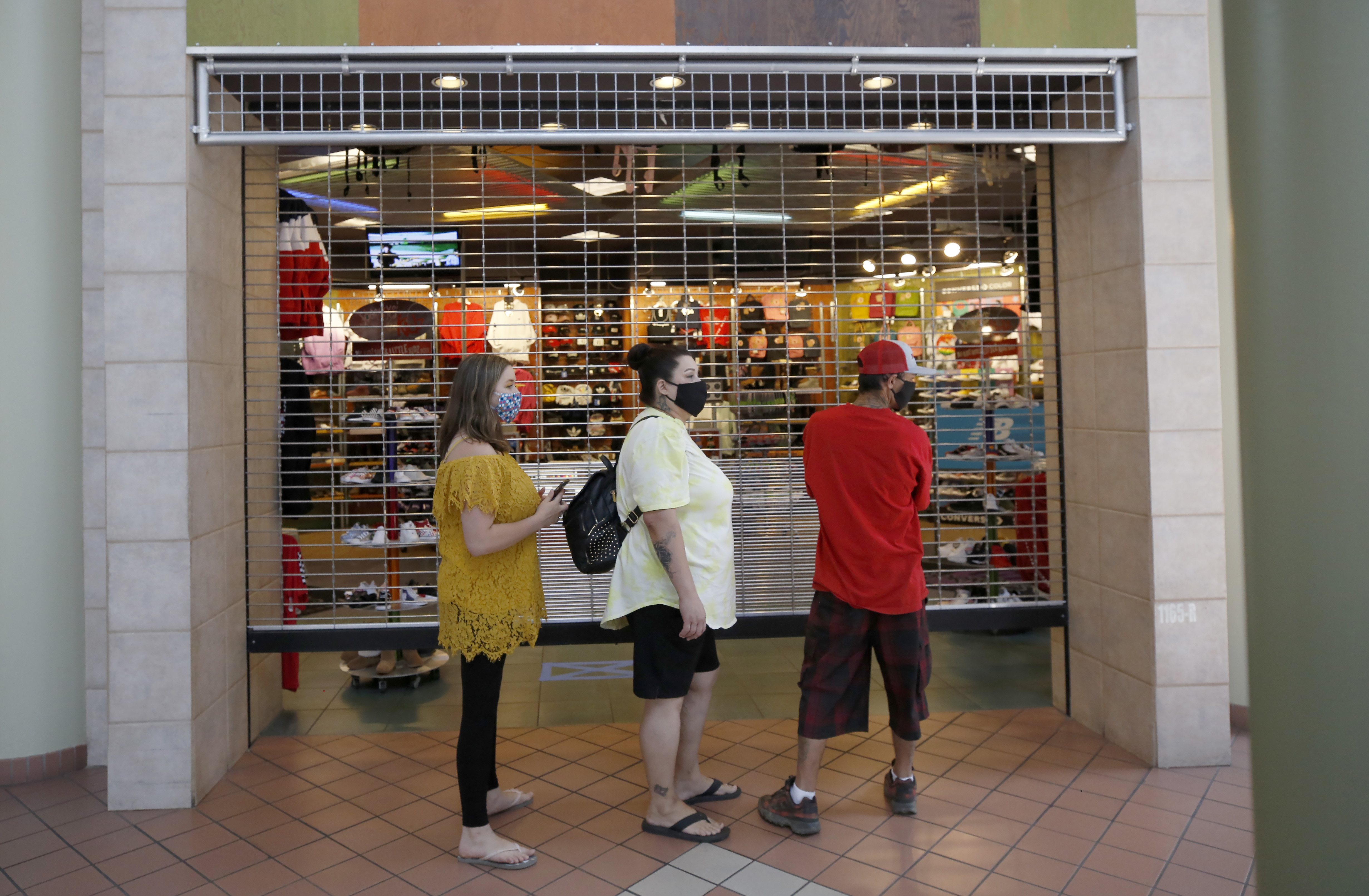 People wait for a Journey's shoe store to open at the Yuba Sutter Mall in Yuba City, California, on May 6.