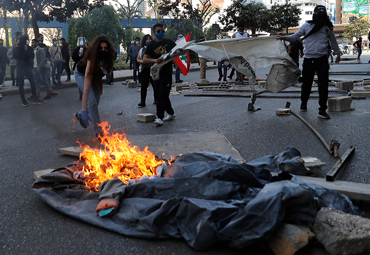 Anti-government protesters set fires to block roads during a protest against the deepening financial crisis, in Beirut, Lebanon, Tuesday, April 28.