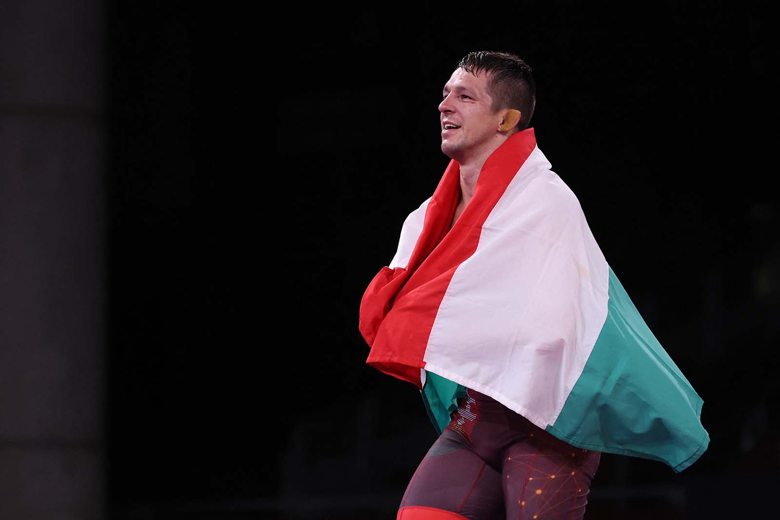 Hungary's Tamas Lorincz celebrates his gold medal victory against Kyrgyzstan's Akzhol Makhmudov in the men's Greco-Roman 77kg wrestling final match on August 3.